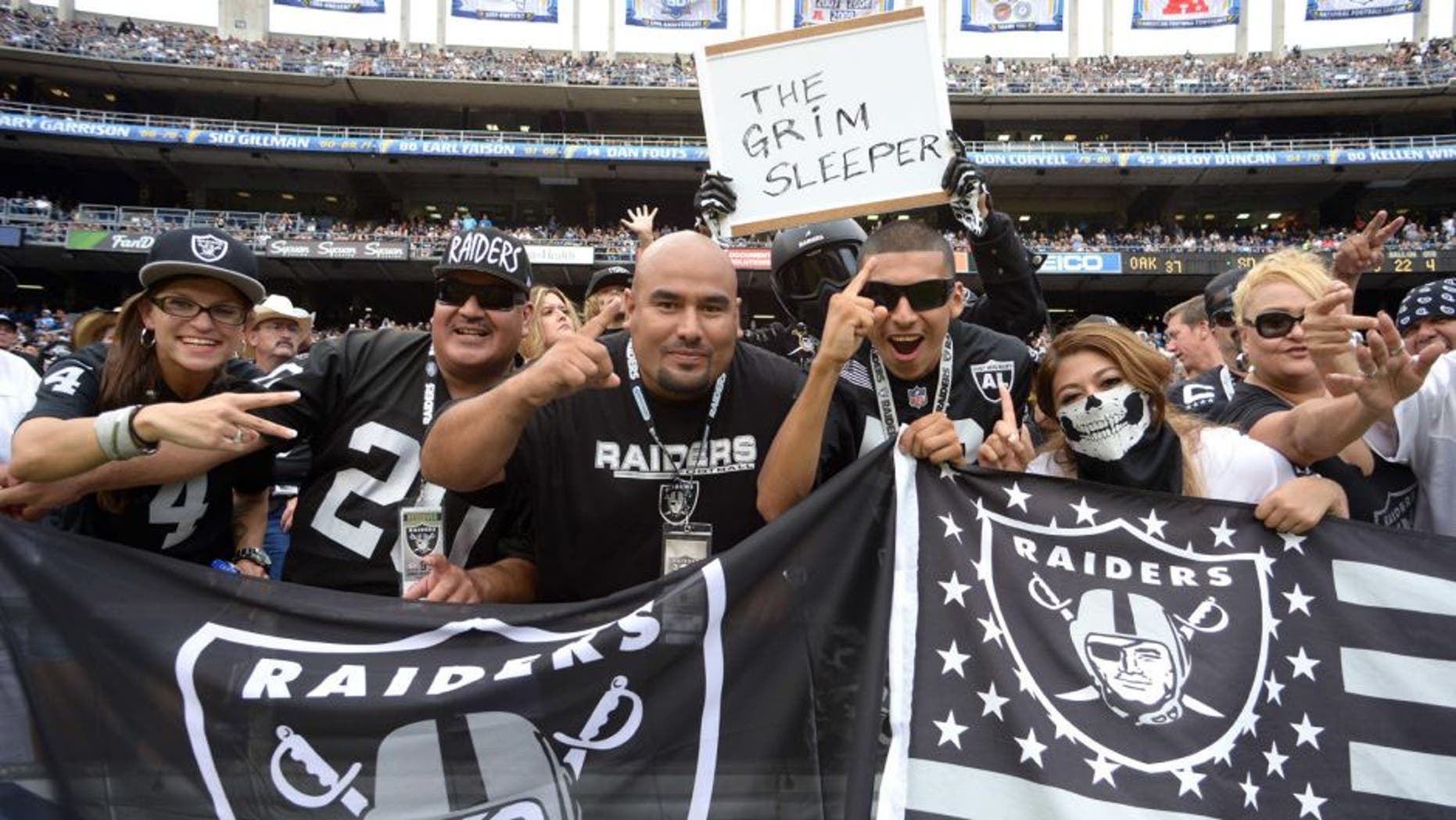 Oct 25, 2015; San Diego, CA, USA; Oakland Raiders fans cheer during the fourth quarter against the San Diego Chargers at Qualcomm Stadium. Mandatory Credit: Jake Roth-USA TODAY Sports