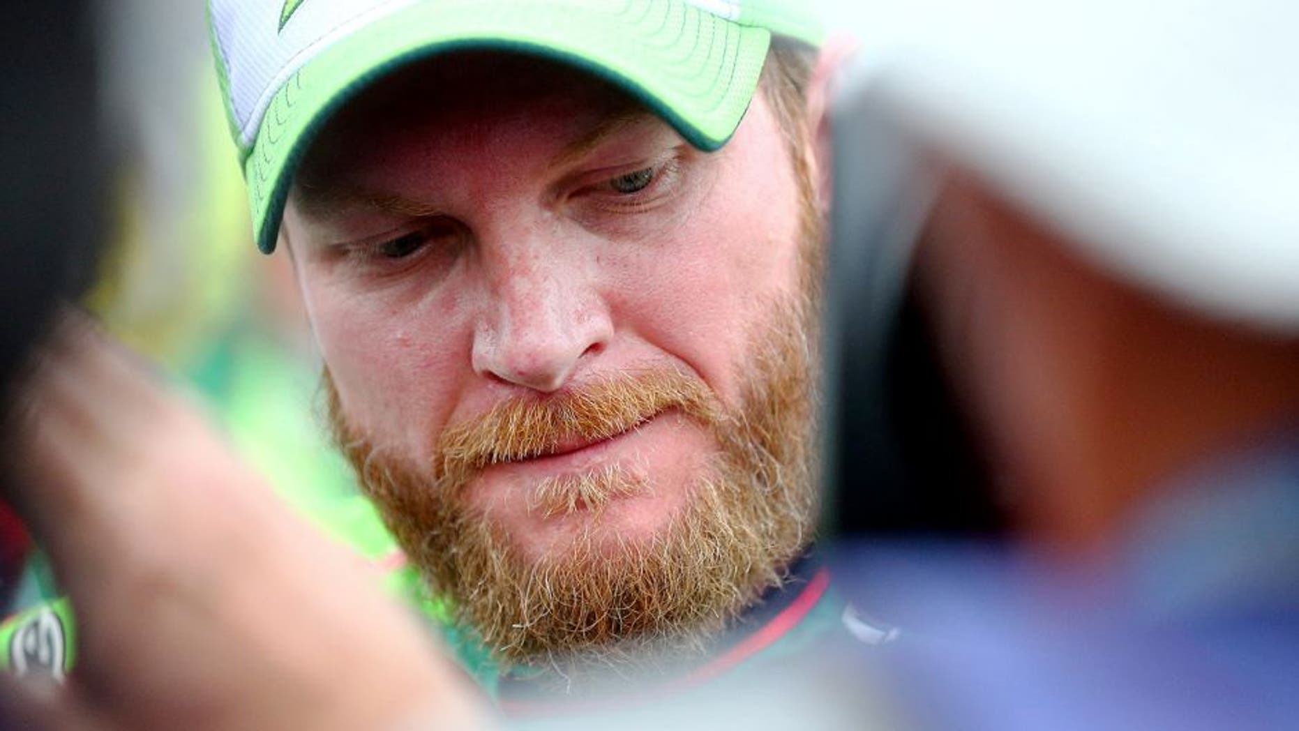 TALLADEGA, AL - OCTOBER 25: Dale Earnhardt Jr., driver of the #88 Diet Mountain Dew Chevrolet, looks on after the NASCAR Sprint Cup Series CampingWorld.com 500 at Talladega Superspeedway on October 25, 2015 in Talladega, Alabama. (Photo by Sarah Crabill/Getty Images)