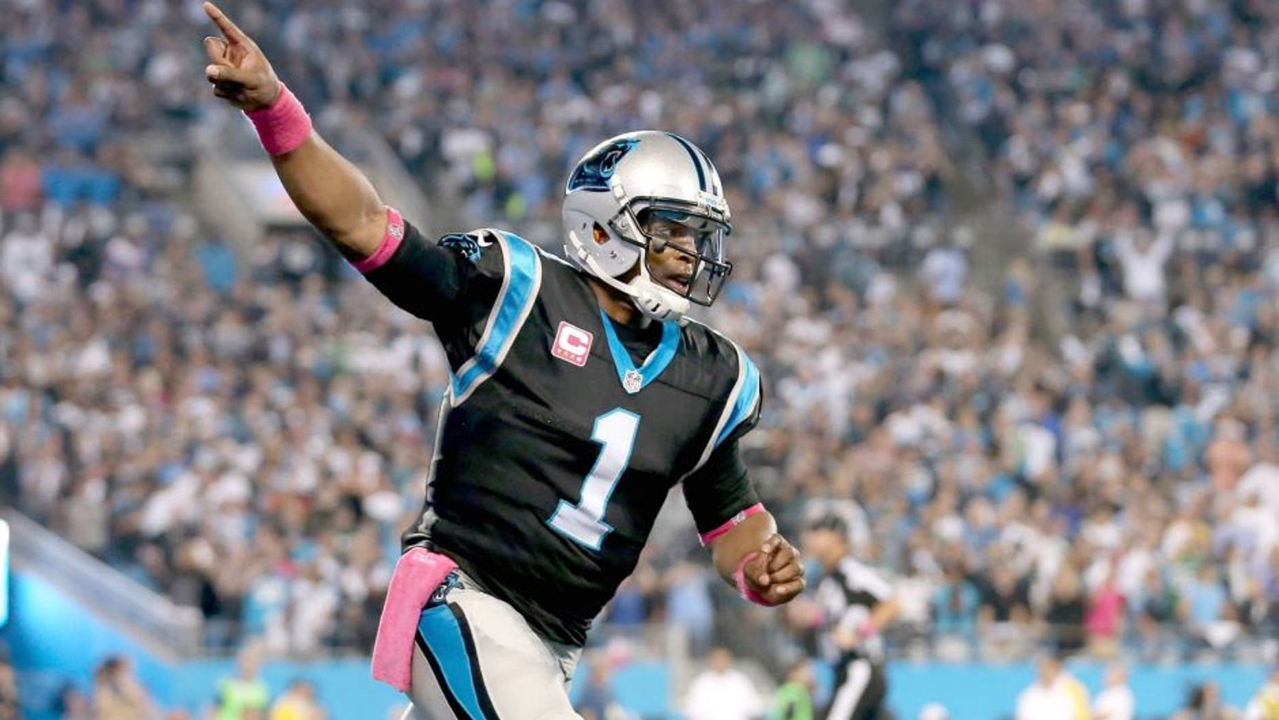 CHARLOTTE, NC - OCTOBER 25: Cam Newton #1 of the Carolina Panthers salutes the crowd after their first touchdown against the Philadelphia Eagles at Bank of America Stadium on October 25, 2015 in Charlotte, North Carolina. (Photo by Streeter Lecka/Getty Images)