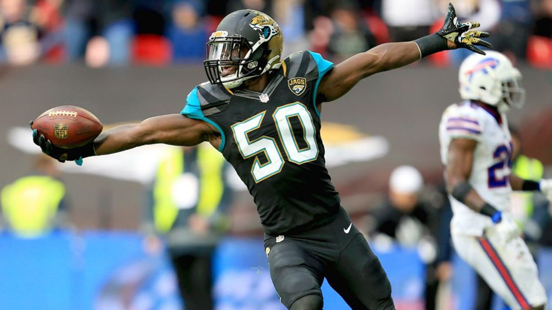LONDON, ENGLAND - OCTOBER 25: Telvin Smith of the Jacksonville Jaguars celebrates a touchdown during the second quarter of the NFL game against the Buffalo Bills at Wembley Stadium on October 25, 2015 in London, England. (Photo by Stephen Pond/Getty Images)