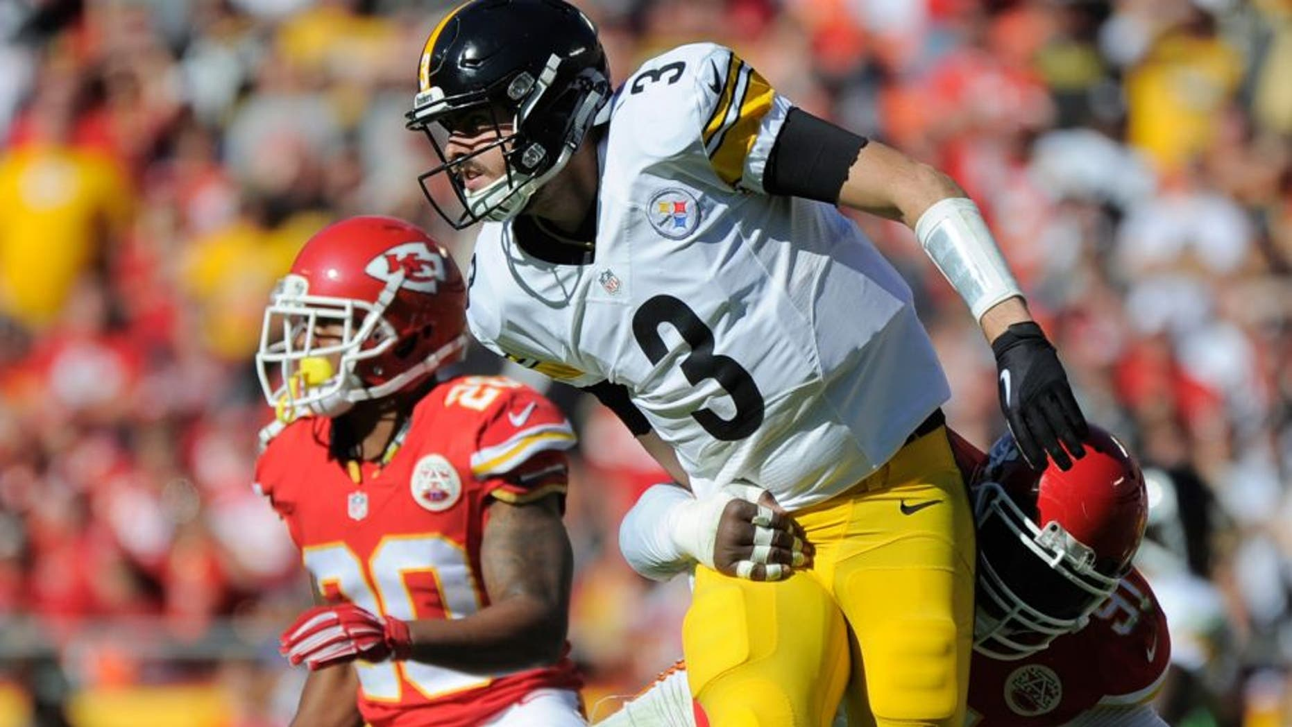 Kansas City Chiefs linebacker Tamba Hali (91) sacks Pittsburgh Steelers quarterback Landry Jones (3) for a turnover during the second half of an NFL football game in Kansas City, Mo., Sunday, Oct. 25, 2015. The Chiefs won 23-13. (AP Photo/Ed Zurga)