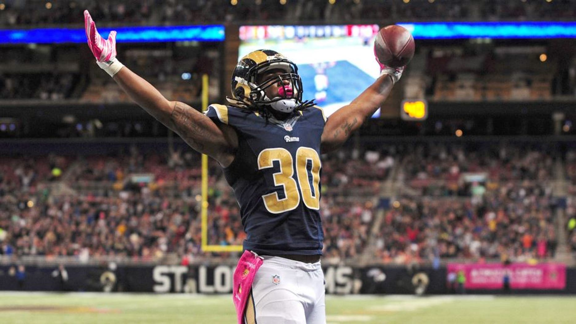 Oct 25, 2015; St. Louis, MO, USA; St. Louis Rams running back Todd Gurley (30) celebrates after scoring a one yard touchdown against the Cleveland Browns during the second half at the Edward Jones Dome. St. Louis defeated Cleveland 24-6. Mandatory Credit: Jeff Curry-USA TODAY Sports