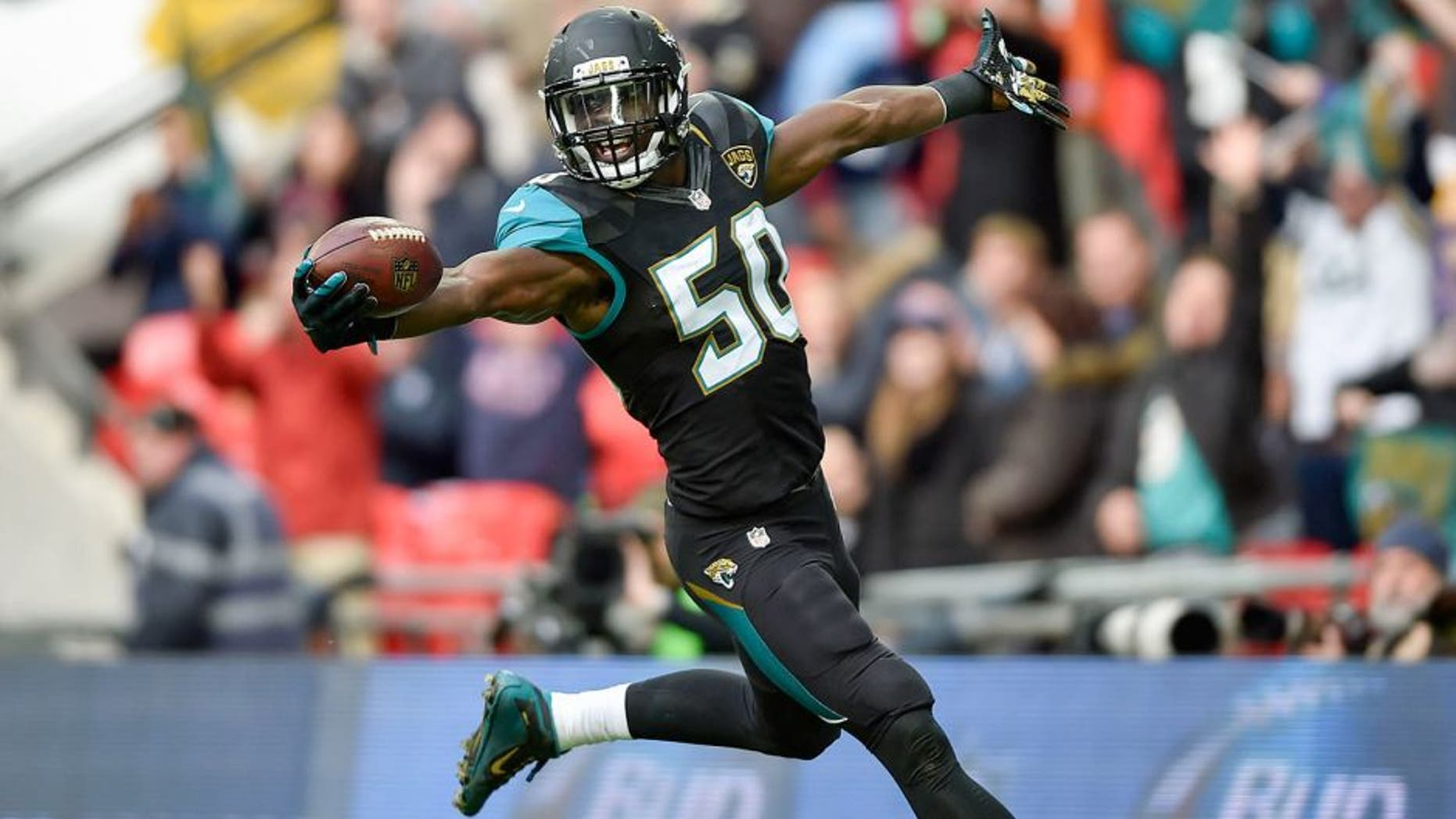 Oct 25, 2015; London, United Kingdom; Jacksonville Jaguars outside linebacker Telvin Smith (50) reacts after scoring a touchdown during the first half of the game against the Buffalo Bills at Wembley Stadium. Mandatory Credit: Steve Flynn-USA TODAY Sports