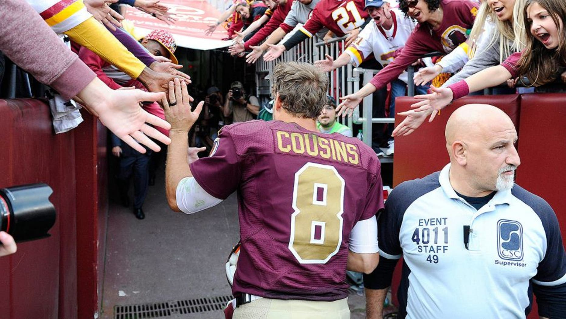 Oct 25, 2015; Landover, MD, USA; Washington Redskins quarterback Kirk Cousins (8) is congratulated by fans after the game between the Washington Redskins and the Tampa Bay Buccaneers at FedEx Field. The Washington Redskins won 31 - 30. Mandatory Credit: Brad Mills-USA TODAY Sports