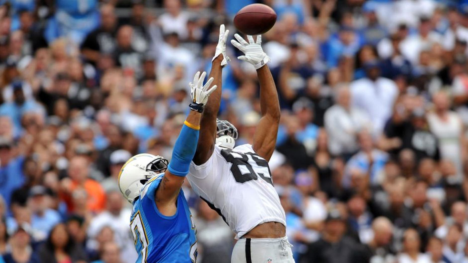 Oct 25, 2015; San Diego, CA, USA; Oakland Raiders wide receiver Amari Cooper (89) catches a pass while defended by San Diego Chargers defensive back Jimmy Wilson (27) during the second quarter at Qualcomm Stadium. Mandatory Credit: Orlando Ramirez-USA TODAY Sports