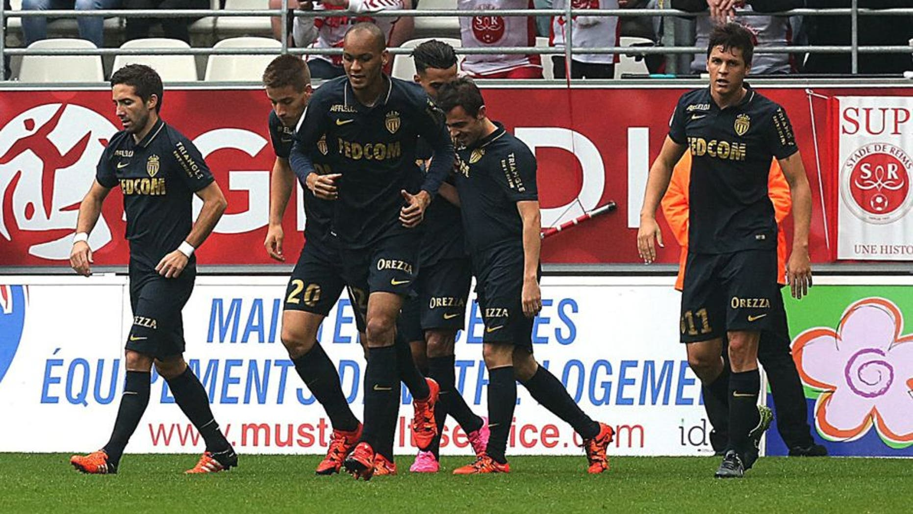 Monaco's Portuguese midfielder Silva Bernardo (2nd R) celebrates with teammates after scoring a goal during the French Ligue 1 football match between Reims and Monaco on October 25, 2015 at the Auguste Delaune Stadium in Reims. AFP PHOTO / FRANCOIS NASCIMBENI (Photo credit should read FRANCOIS NASCIMBENI/AFP/Getty Images)