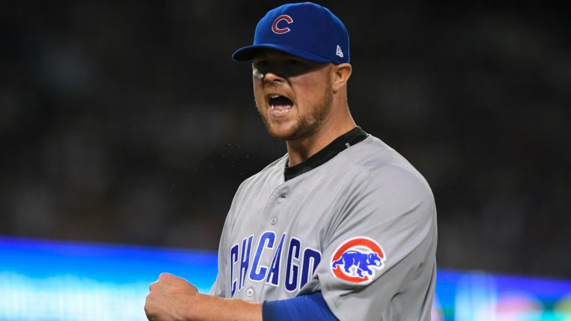 Chicago Cubs starting pitcher Jon Lester reacts after getting out of the seventh inning of Game 5 of the National League baseball championship series against the Los Angeles Dodgers Thursday, Oct. 20, 2016, in Los Angeles. (AP Photo/Mark J. Terrill)