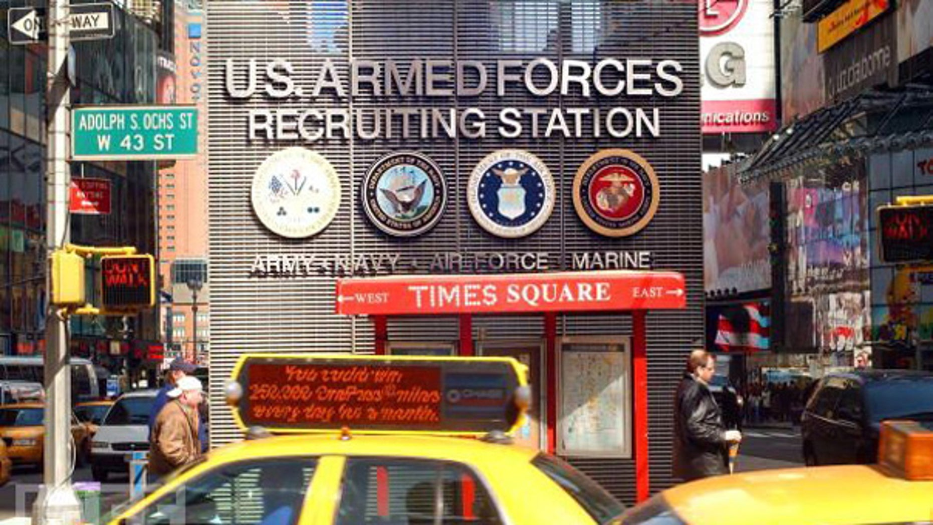 Taxis and pedestrians pass by the Times Square U.S. Armed Forces Recruiting Station.