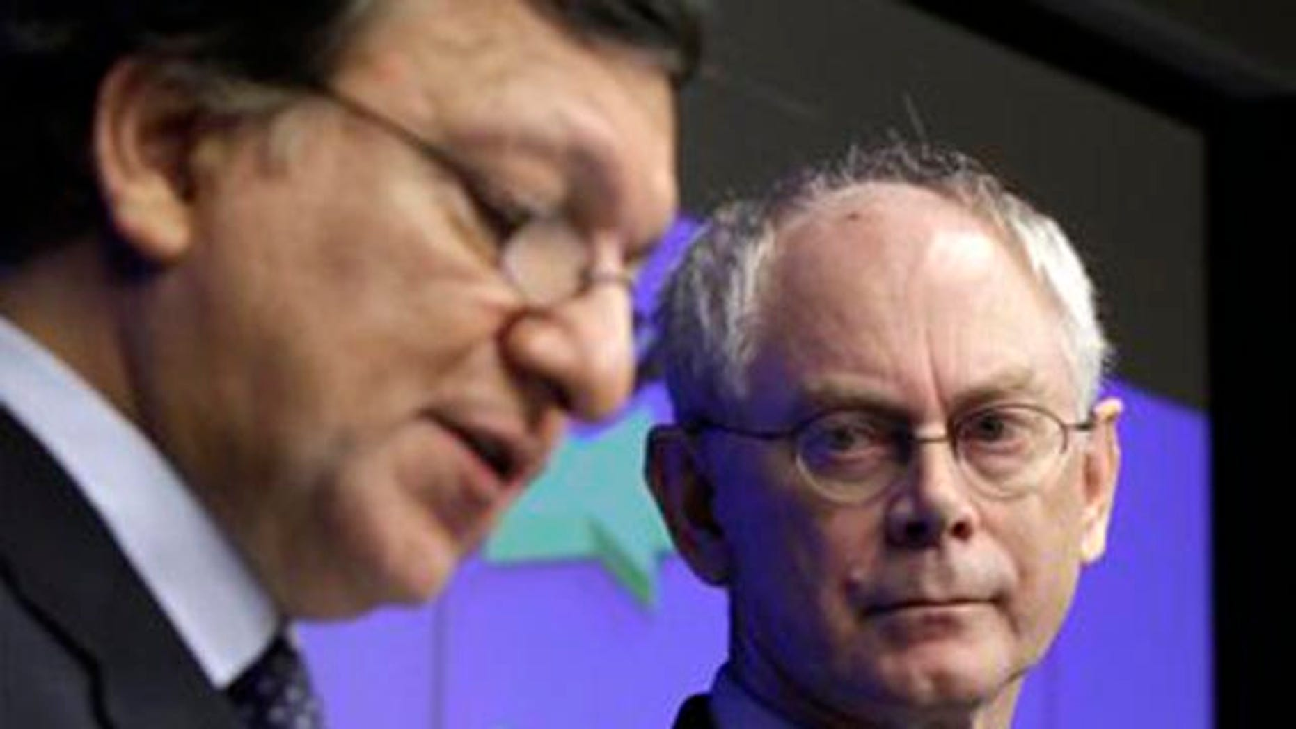 October 27, 2011: European Council President Herman Van Rompuy, right, and European Commission President Jose Manuel Barroso participate in a media conference after an EU summit in Brussels.