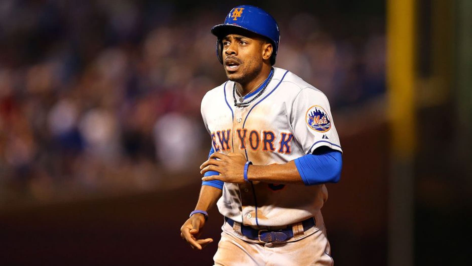 CHICAGO, IL - OCTOBER 20: Curtis Granderson #3 of the New York Mets runs back to the dugout after being tagged out at second base in the first inning against the Chicago Cubs during game three of the 2015 MLB National League Championship Series at Wrigley Field on October 20, 2015 in Chicago, Illinois. (Photo by Elsa/Getty Images)