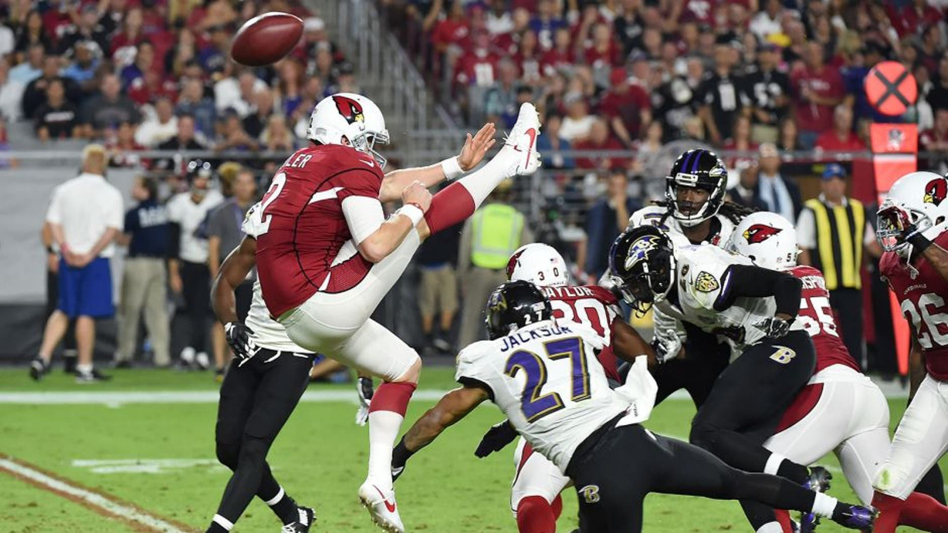 GLENDALE, AZ - OCTOBER 26: Drew Butler's #2 of the Arizona Cardinals punt is blocked by cornerback Asa Jackson #27 of the Baltimore Ravens in the fourth quarter of the NFL game at University of Phoenix Stadium on October 26, 2015 in Glendale, Arizona. (Photo by Norm Hall/Getty Images)