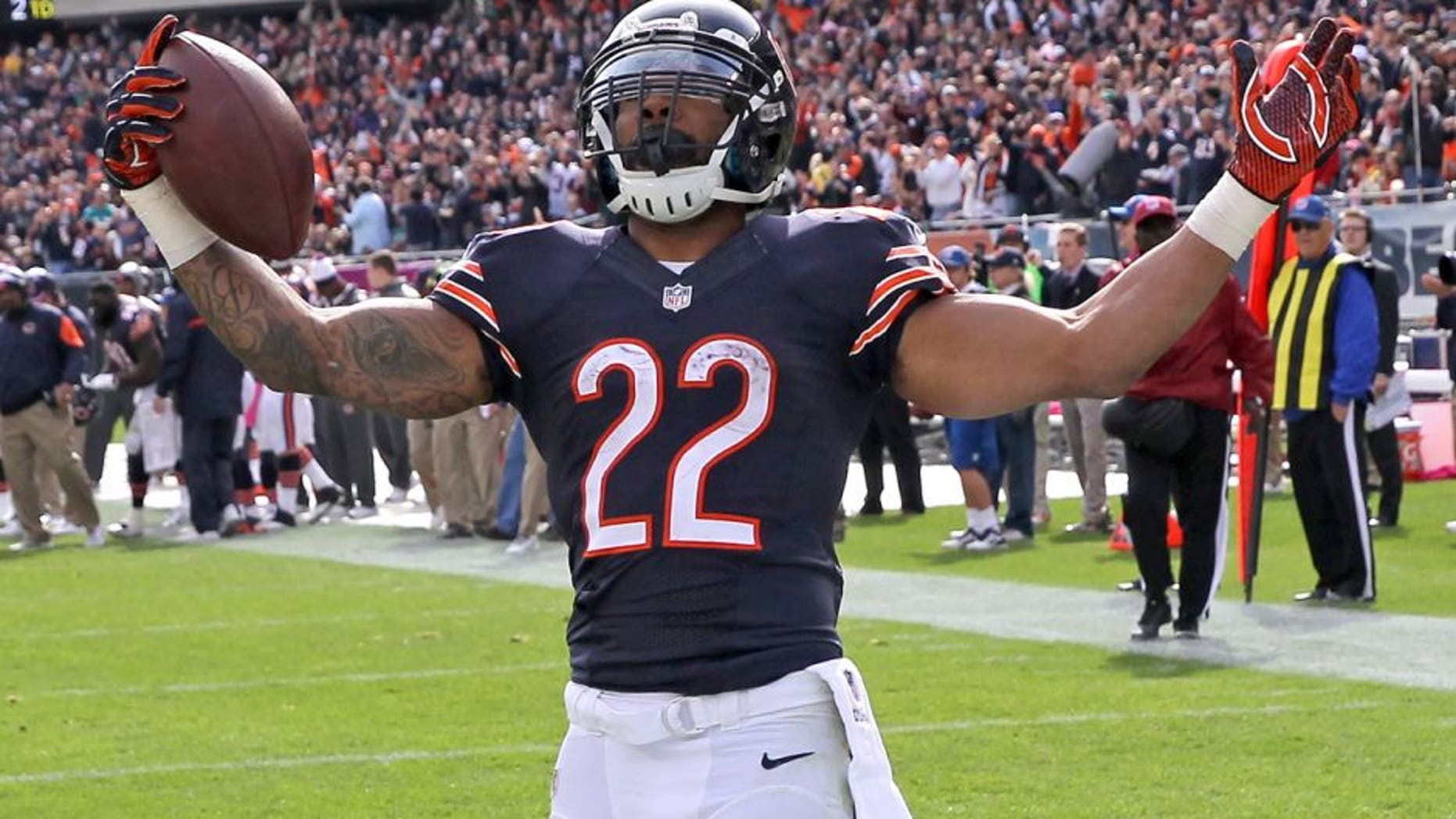 CHICAGO, IL - OCTOBER 19: Matt Forte #22 of the Chicago Bears celebrates his touchdown during the third quarter of a game against the Miami Dolphins at Soldier Field on October 19, 2014 in Chicago, Illinois. (Photo by Jonathan Daniel/Getty Images)
