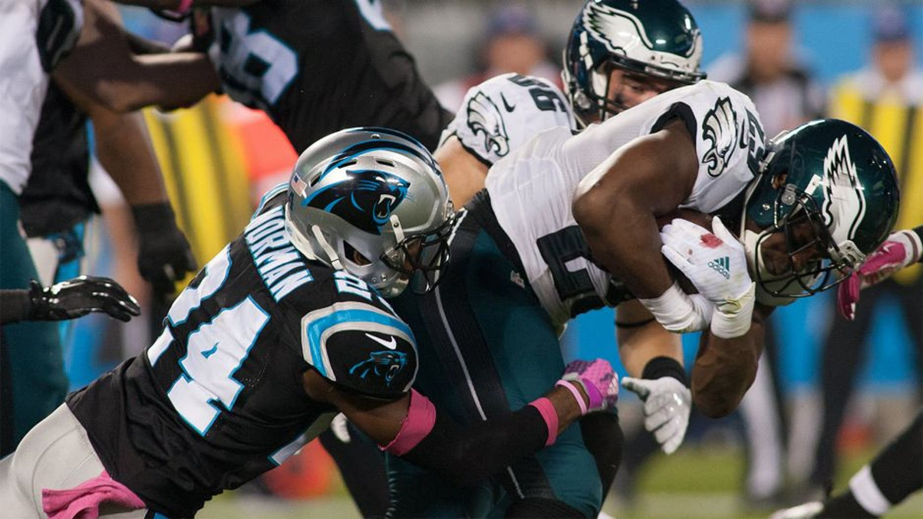 Oct 25, 2015; Charlotte, NC, USA; Philadelphia Eagles running back DeMarco Murray (29) gets tackled by Carolina Panthers cornerback Josh Norman (24) during the first quarter at Bank of America Stadium. Mandatory Credit: Jeremy Brevard-USA TODAY Sports