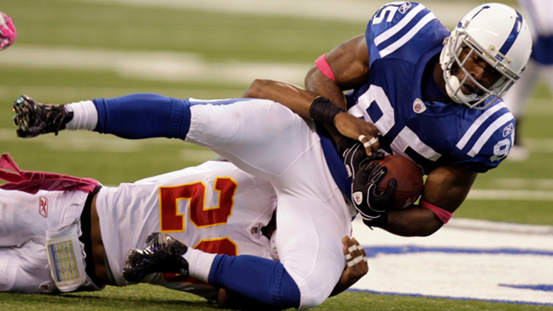 Oct. 10: Indianapolis Colts wide receiver Pierre Garcon, right, is tackled by Kansas City Chiefs defensive back Eric Berry during the second half of an NFL football game in Indianapolis.