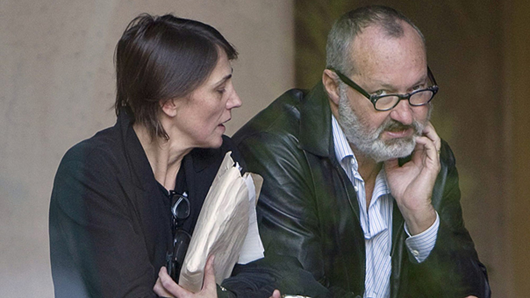 Oct. 27: Actor Randy Quaid, right, and his wife Evi wait are seen inside the building of his lawyers office in Vancouver, British Columbia, Canada.