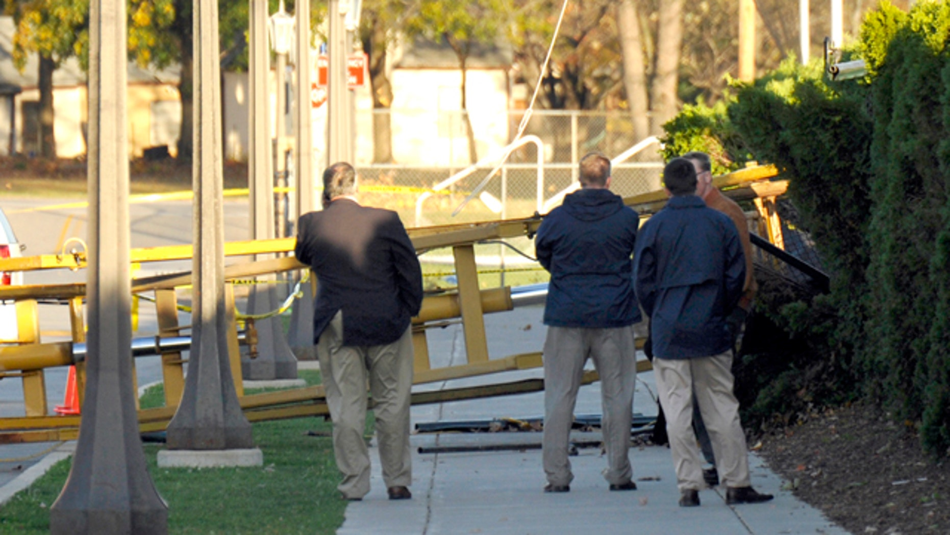 Oct. 27: Notre Dame personnel examine a location where a tower used to video Notre Dame football practice blew over in South Bend, Ind.
