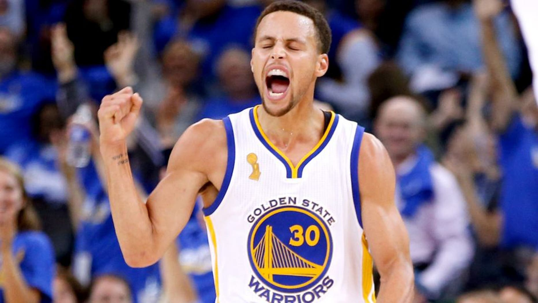 OAKLAND, CA - OCTOBER 27: Stephen Curry #30 of the Golden State Warriors celebrates after a three point basket against the New Orleans Pelicans during the NBA season opener at ORACLE Arena on October 27, 2015 in Oakland, California. NOTE TO USER: User expressly acknowledges and agrees that, by downloading and or using this photograph, User is consenting to the terms and conditions of the Getty Images License Agreement. (Photo by Ezra Shaw/Getty Images)