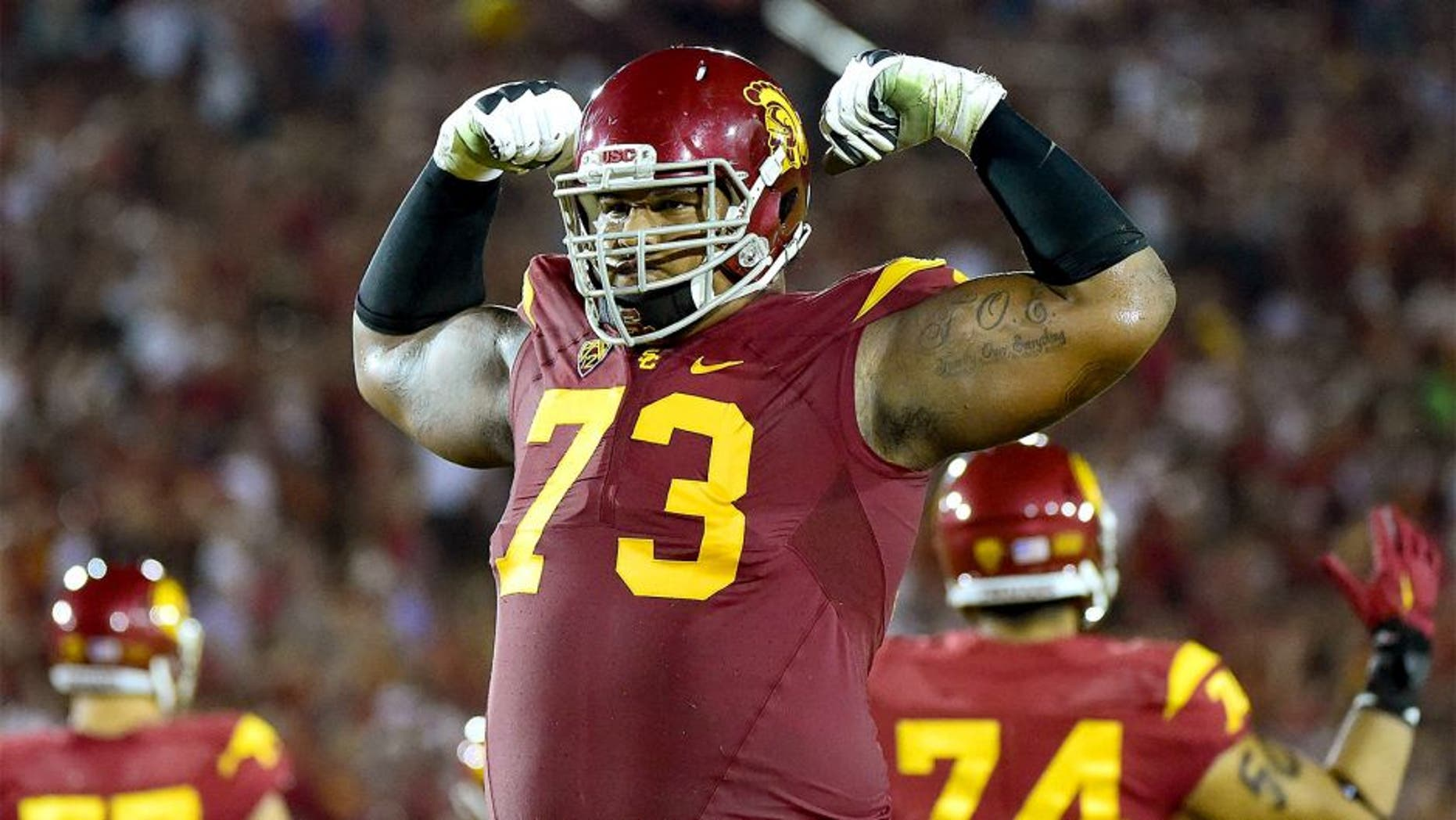 LOS ANGELES, CA - OCTOBER 24: Zach Banner #73 of the USC Trojans celebrates a touchdown to take a 35-17 win over the Utah Utes during the third quarter at Los Angeles Memorial Coliseum on October 24, 2015 in Los Angeles, California. (Photo by Harry How/Getty Images)