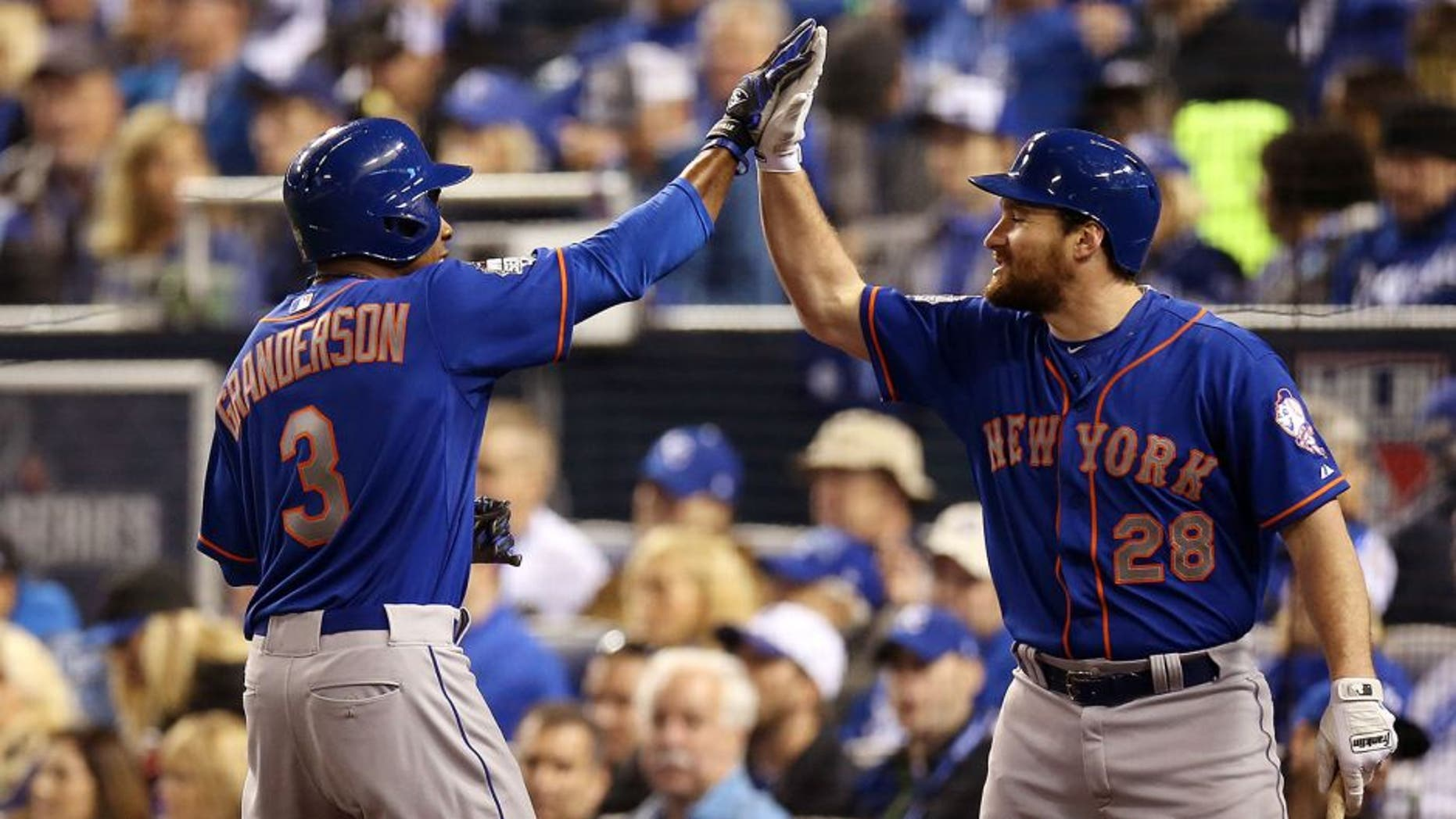 KANSAS CITY, MO - OCTOBER 27: Curtis Granderson #3 of the New York Mets celebrates with Daniel Murphy #28 after hitting a home run in the fifth inning during Game 1 of the 2015 World Series against the Kansas City Royals at Kauffman Stadium on Tuesday, October 27, 2015 in Kansas City, Missouri. (Photo by Brad Mangin/MLB Photos via Getty Images)