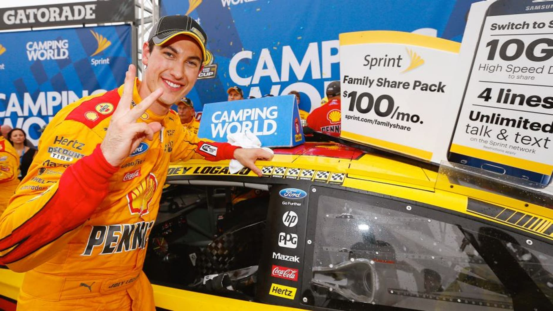 Joey Logano, driver of the #22 Shell Pennzoil Ford, poses with the winner's decal in Victory Lane after winning the NASCAR Sprint Cup Series CampingWorld.com 500 at Talladega Superspeedway on October 25, 2015 in Talladega, Alabama. (Photo by Jonathan Ferrey/NASCAR via Getty Images)