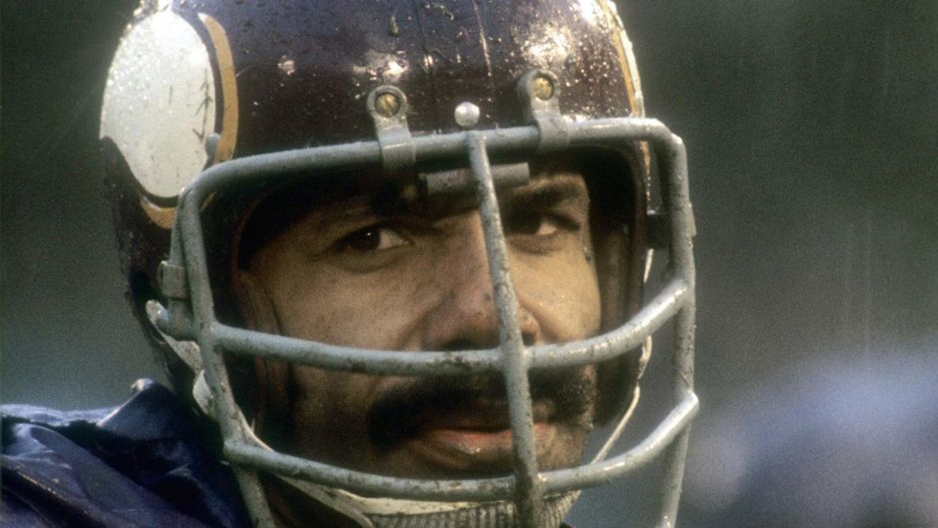 CIRCA 1970: Jim Marshall #70 of the Minnesota Vikings watches the action from the sidelines during an NFL football game circa 1970. Marshall played for the Vikings from 1961-79. (Photo by Focus on Sport/Getty Images)