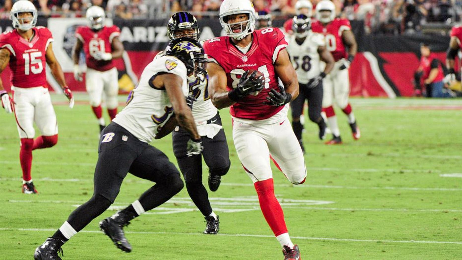 Oct 26, 2015; Glendale, AZ, USA; Baltimore Ravens strong safety Will Hill (33) hits Arizona Cardinals tight end Jermaine Gresham (84) during the first half at University of Phoenix Stadium. Mandatory Credit: Matt Kartozian-USA TODAY Sports