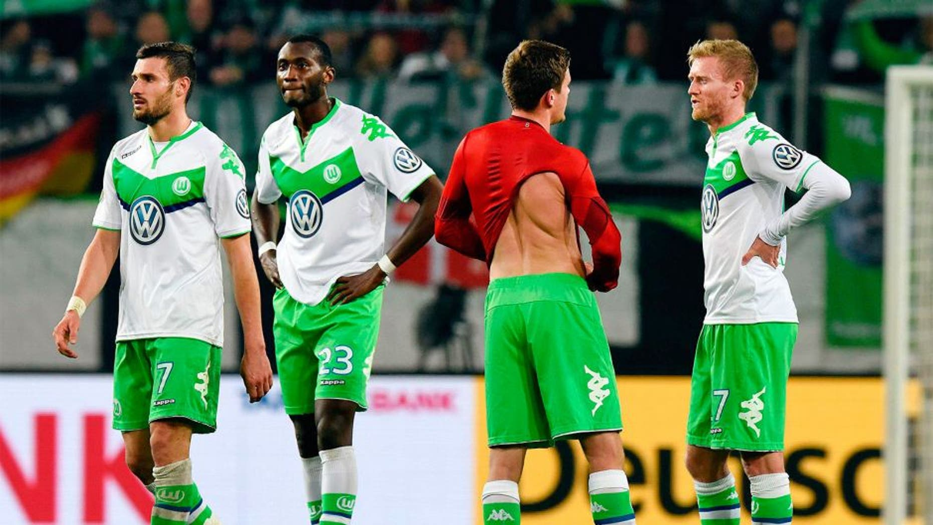 VfL Wolfsburg players react after their German cup (DFB Pokal) second round soccer match against Bayern Munich in Wolfsburg, Germany, October 27, 2015. REUTERS/Fabian Bimmer DFB RULES PROHIBIT USE IN MMS SERVICES VIA HANDHELD DEVICES UNTIL TWO HOURS AFTER A MATCH AND ANY USAGE ON INTERNET OR ONLINE MEDIA SIMULATING VIDEO FOOTAGE DURING THE MATCH. Picture Supplied by Action Images
