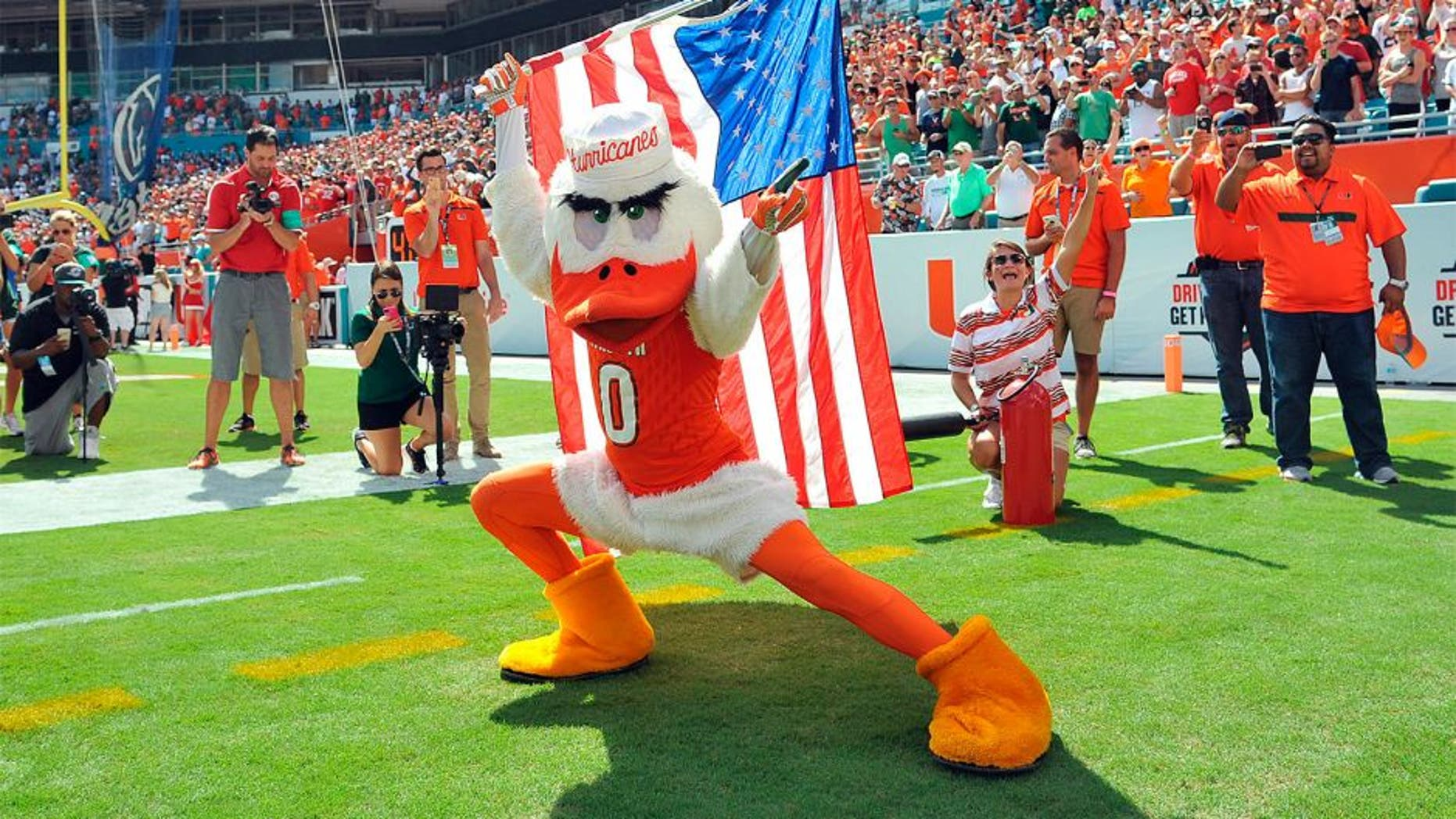 Sep 19, 2015; Miami Gardens, FL, USA; Miami Hurricanes mascot Sebastian carries the American flag before a game against Nebraska Cornhuskers at Sun Life Stadium. Miami won 36-33. Mandatory Credit: Steve Mitchell-USA TODAY Sports
