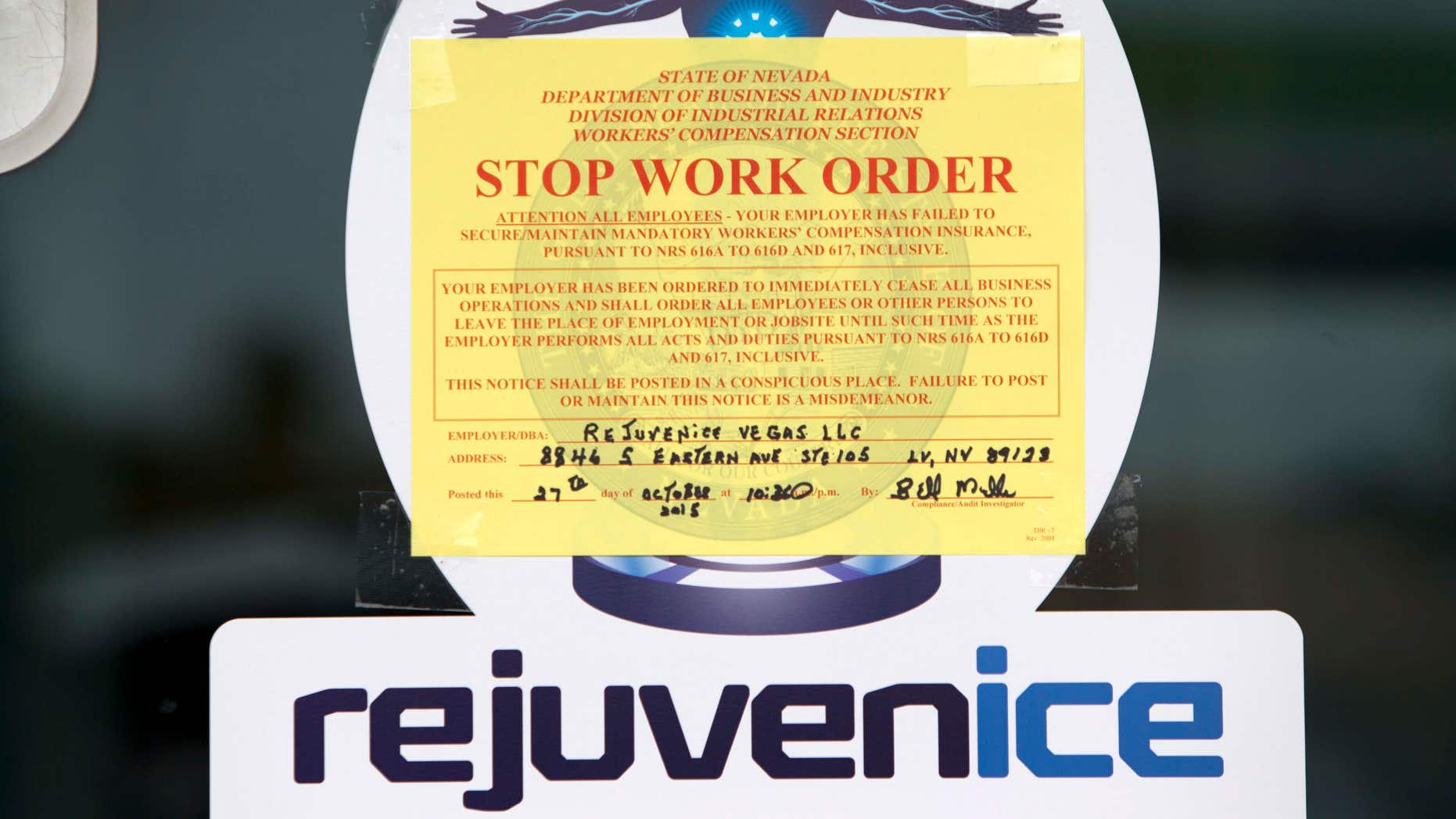 Oct. 27, 2015: A Stop Work Order is shown on the front door of the Rejuvenice spa in Las Vegas.