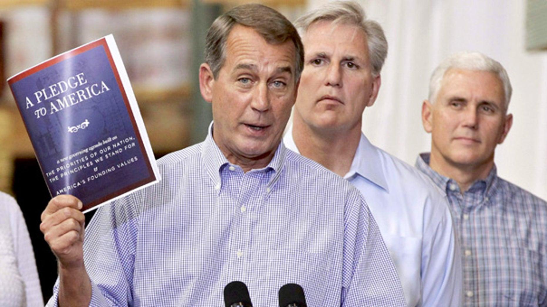 "FILE: House Minority Leader John Boehner holds a copy of the GOP agenda, ""A Pledge to America,"" in Sterling, Va., on Sept. 23."