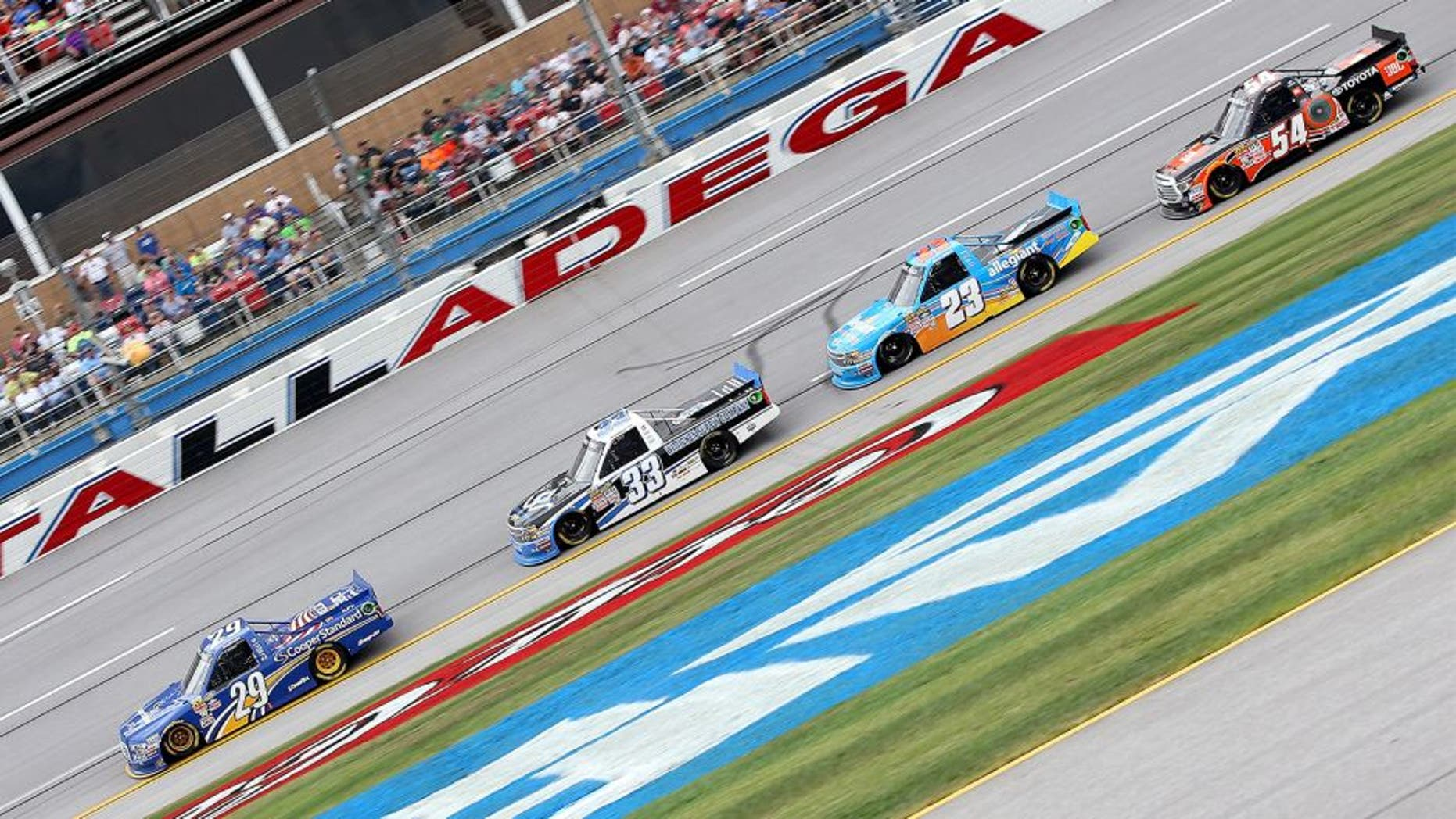 TALLADEGA, AL - OCTOBER 24: Brian Keselowski, driver of the #29 Cooper Standard Ford, leads a pack of trucks during the NASCAR Camping World Truck Series fred's 250 at Talladega Superspeedway on October 24, 2015 in Talladega, Alabama. (Photo by Sean Gardner/NASCAR via Getty Images)