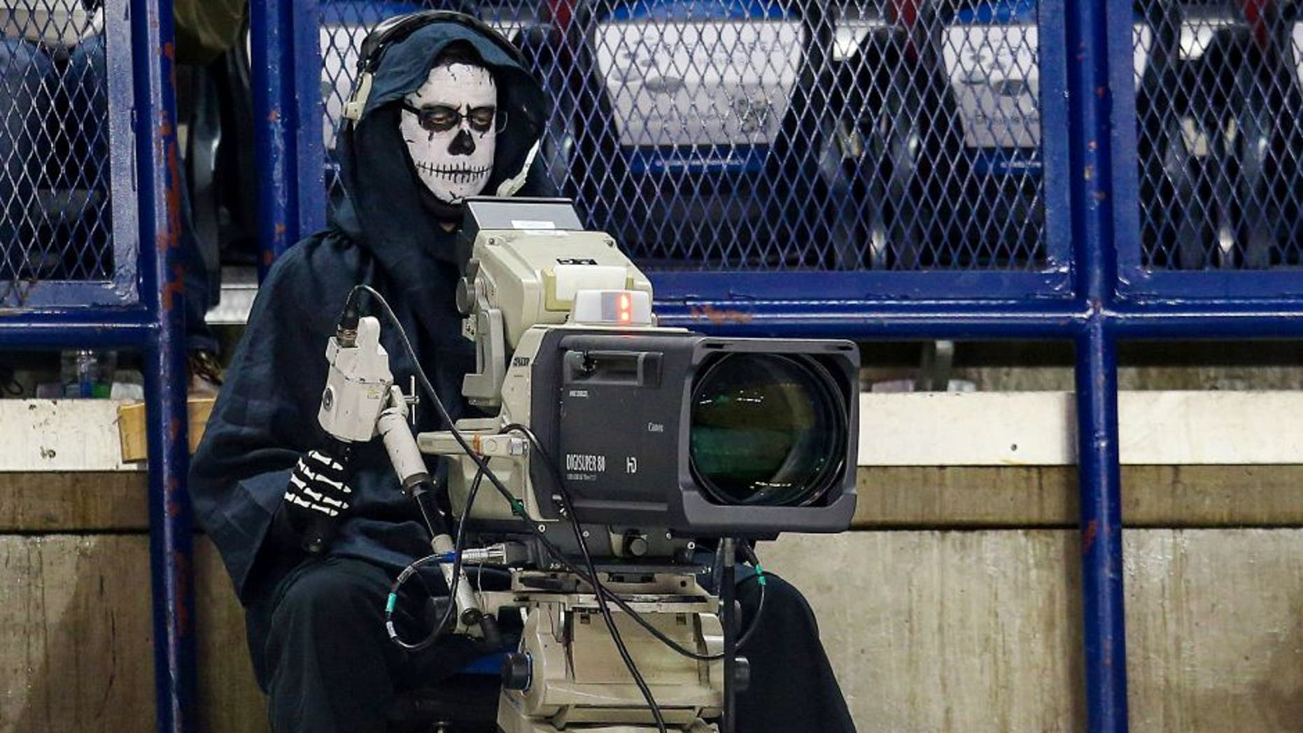 Oct 31, 2014; Calgary, Alberta, CAN; Camera man dressed up for Halloween prior to the game between the Calgary Flames and the Nashville Predators at Scotiabank Saddledome. Calgary Flames won 4-3. Mandatory Credit: Sergei Belski-USA TODAY Sports