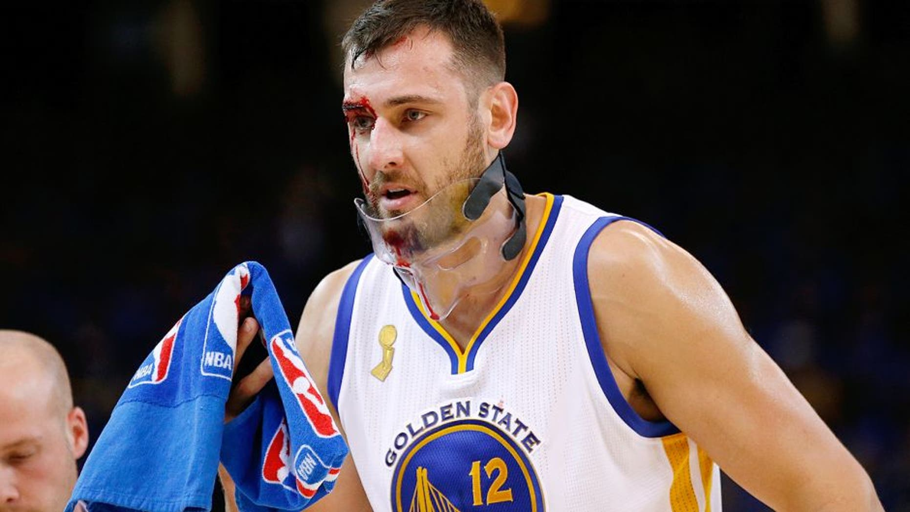 OAKLAND, CA - OCTOBER 27: Andrew Bogut #12 of the Golden State Warriors walks off the court after being cut during the NBA season opener against the New Orleans Pelicans at ORACLE Arena on October 27, 2015 in Oakland, California. NOTE TO USER: User expressly acknowledges and agrees that, by downloading and or using this photograph, User is consenting to the terms and conditions of the Getty Images License Agreement. (Photo by Ezra Shaw/Getty Images)