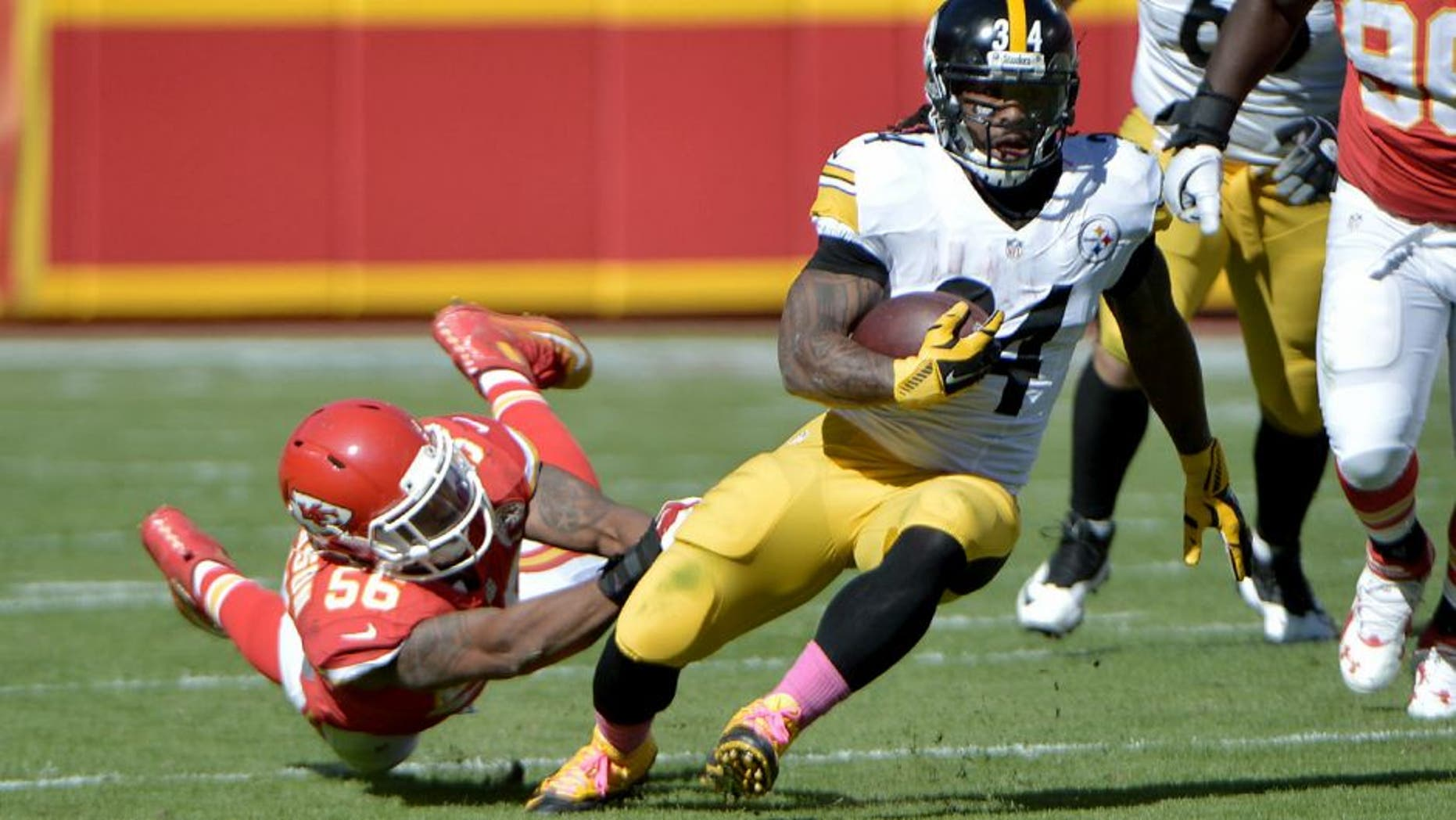 Oct 25, 2015; Kansas City, MO, USA; Pittsburgh Steelers inside linebacker Lawrence Timmons (94) runs the ball as Kansas City Chiefs inside linebacker Derrick Johnson (56) defends during the second half at Arrowhead Stadium. The Chiefs won 23-13. Mandatory Credit: Denny Medley-USA TODAY Sports
