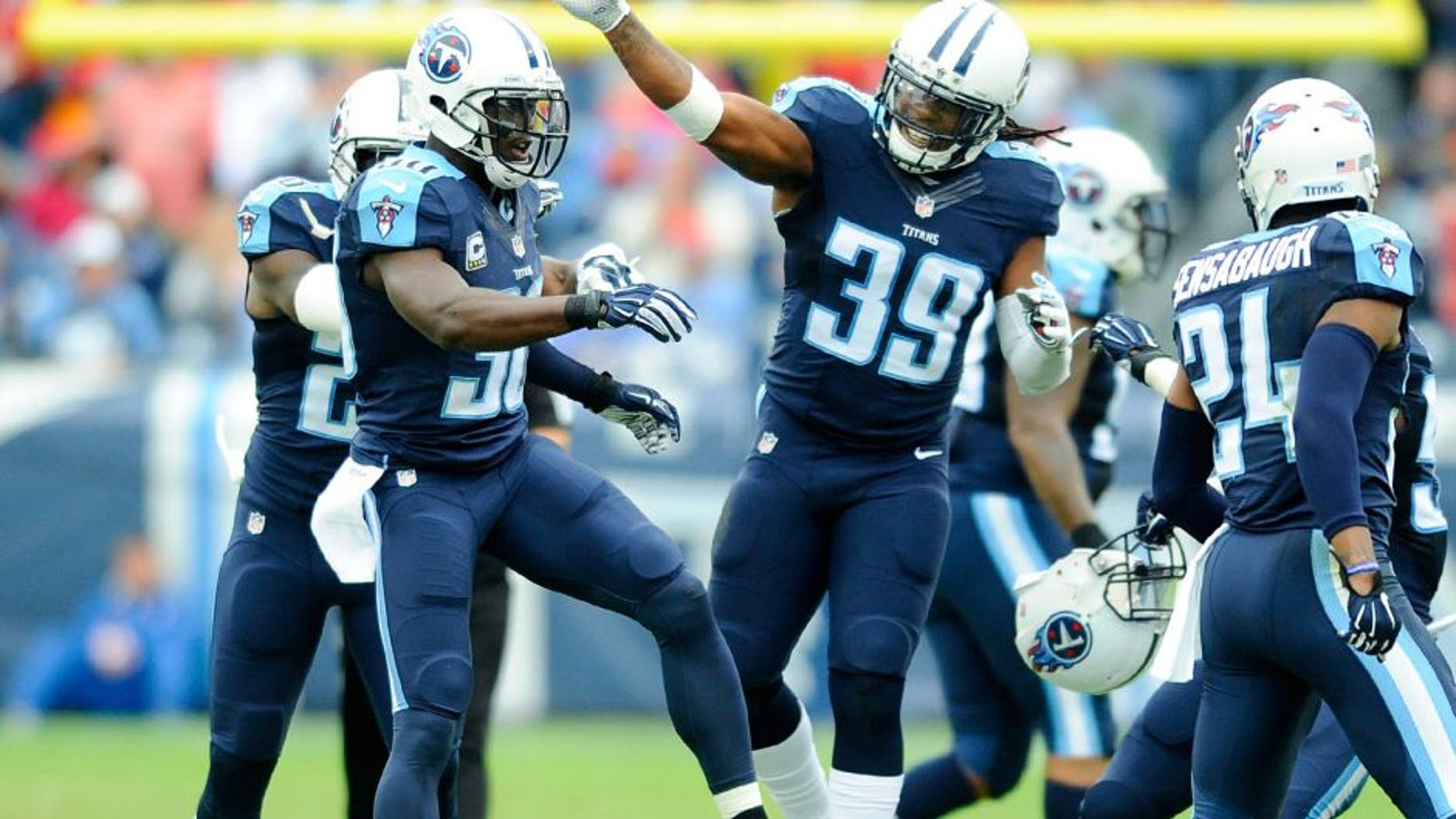 Oct 25, 2015; Nashville, TN, USA; Tennessee Titans cornerback Jason McCourty (30) is congratulated by strong safety Daimion Stafford (39) after a fourth down defensive stop during the first half against the Atlanta Falcons at Nissan Stadium. Mandatory Credit: Christopher Hanewinckel-USA TODAY Sports