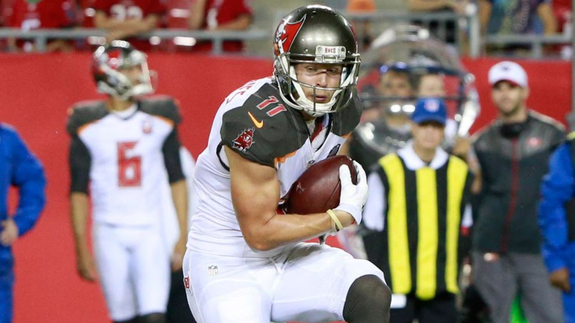 Aug 29, 2015; Tampa, FL, USA; Tampa Bay Buccaneers wide receiver Adam Humphries (11) runs with the ball against the Cleveland Browns during the second half at Raymond James Stadium. Cleveland Browns defeated the Tampa Bay Buccaneers 31-7. Mandatory Credit: Kim Klement-USA TODAY Sports