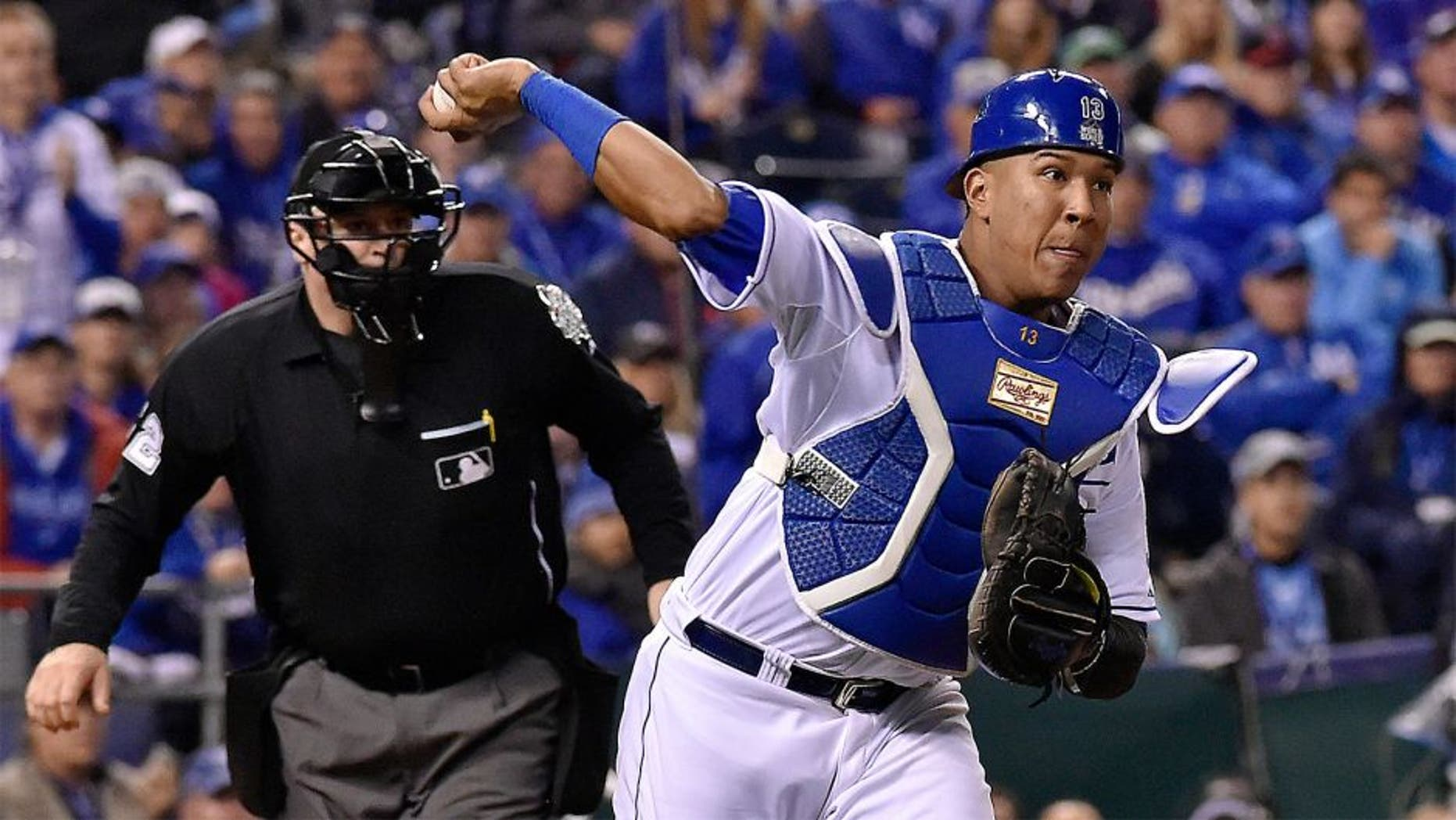Kansas City Royals catcher Salvador Perez throws to first to retire the New York Mets' Daniel Murphy on a third-strike wild pitch in the 12th inning in Game 1 of the World Series on Tuesday, Oct. 27, 2015, at Kauffman Stadium in Kansas City, Mo. (John Sleezer/Kansas City Star/TNS via Getty Images)