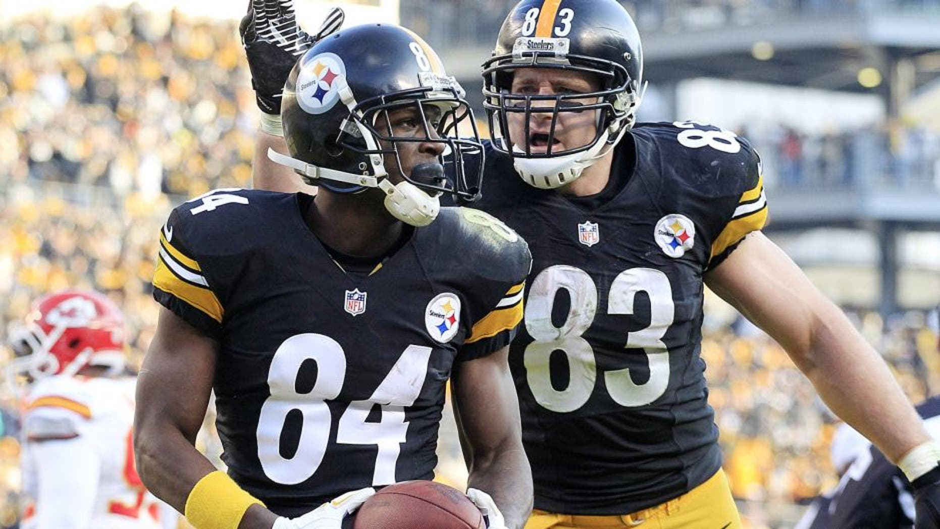 Dec 21, 2014; Pittsburgh, PA, USA; Pittsburgh Steelers wide receiver Antonio Brown (84) and tight end Heath Miller (83) celebrate after Brown scored a touchdown against the Kansas City Chiefs during the third quarter at Heinz Field. The Steelers won 20-12. Mandatory Credit: Charles LeClaire-USA TODAY Sports