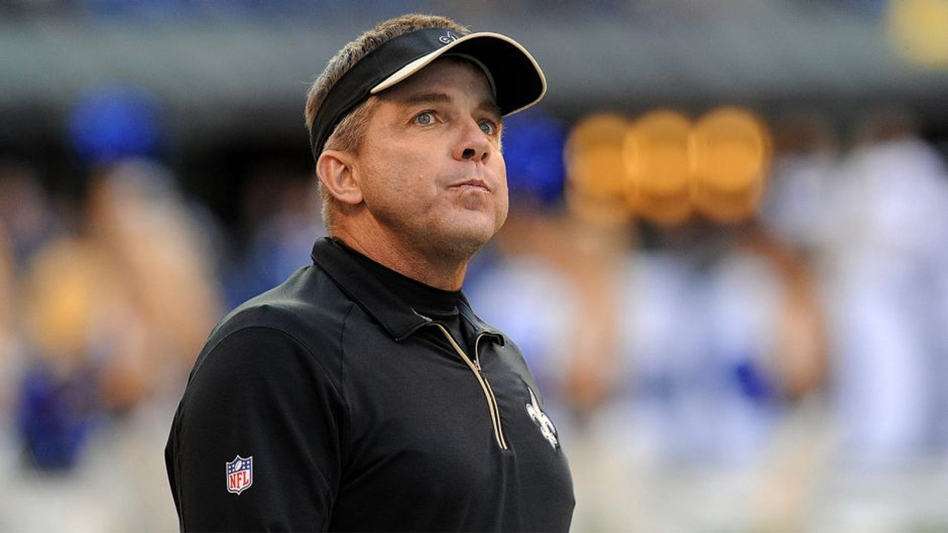 Oct 25, 2015; Indianapolis, IN, USA; New Orleans Saints head coach Sean Payton looks at the scoreboard during the final minutes of their game against the Indianapolis Colts at Lucas Oil Stadium. The Saints went on to win the game, 27-21. Mandatory Credit: Thomas J. Russo-USA TODAY Sports