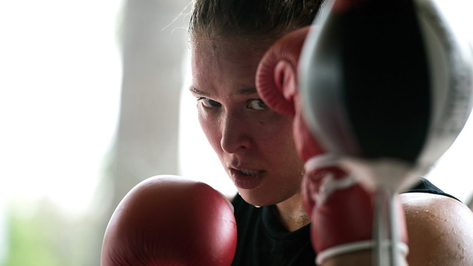 GLENDALE, CA - OCTOBER 27: UFC Bantamweight champion Ronda Rousey cools down after a workout during a media training session at the Glendale Fight Club on October 27, 2015 in Glendale, California. (Photo by Brandon Magnus/Zuffa LLC/Zuffa LLC via Getty Images)