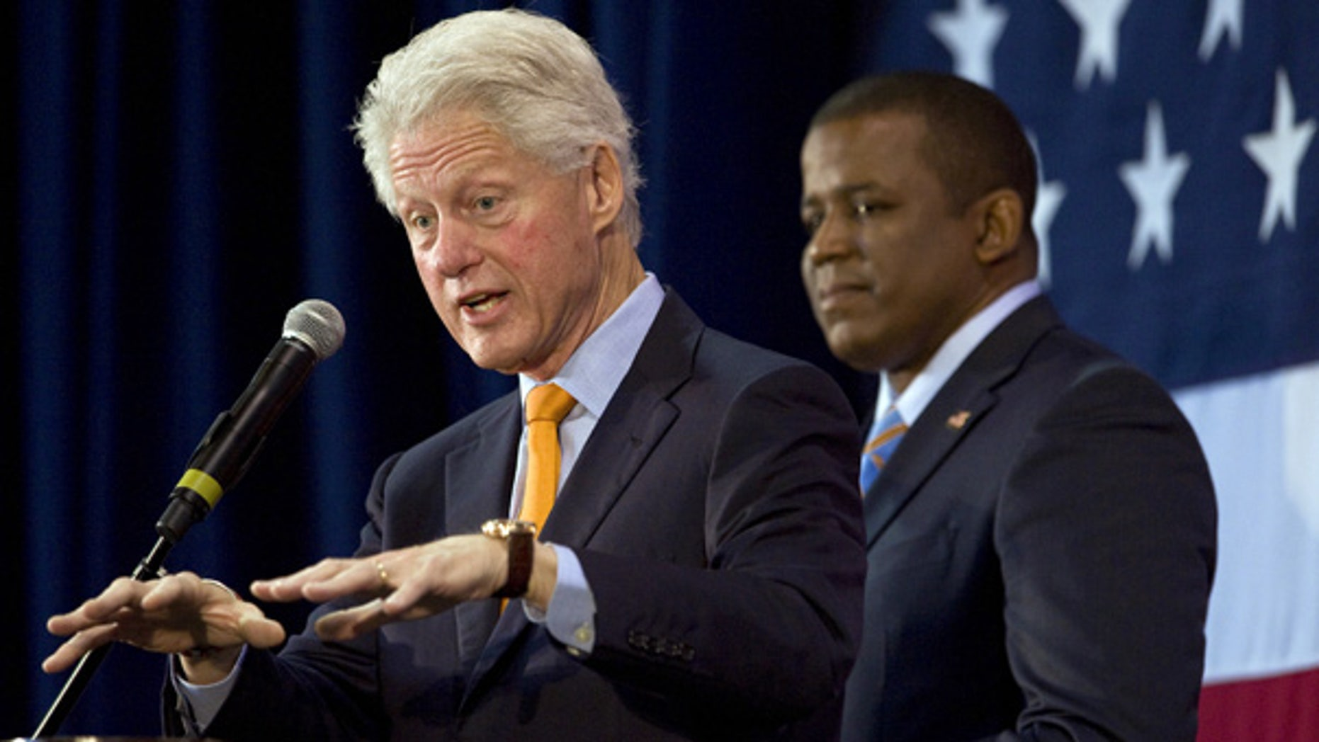 Oct. 19: Florida Democratic Senate candidate Kendrick Meek, right, listens to Former President Bill Clinton address supporters during a campaign rally in St. Petersburg.