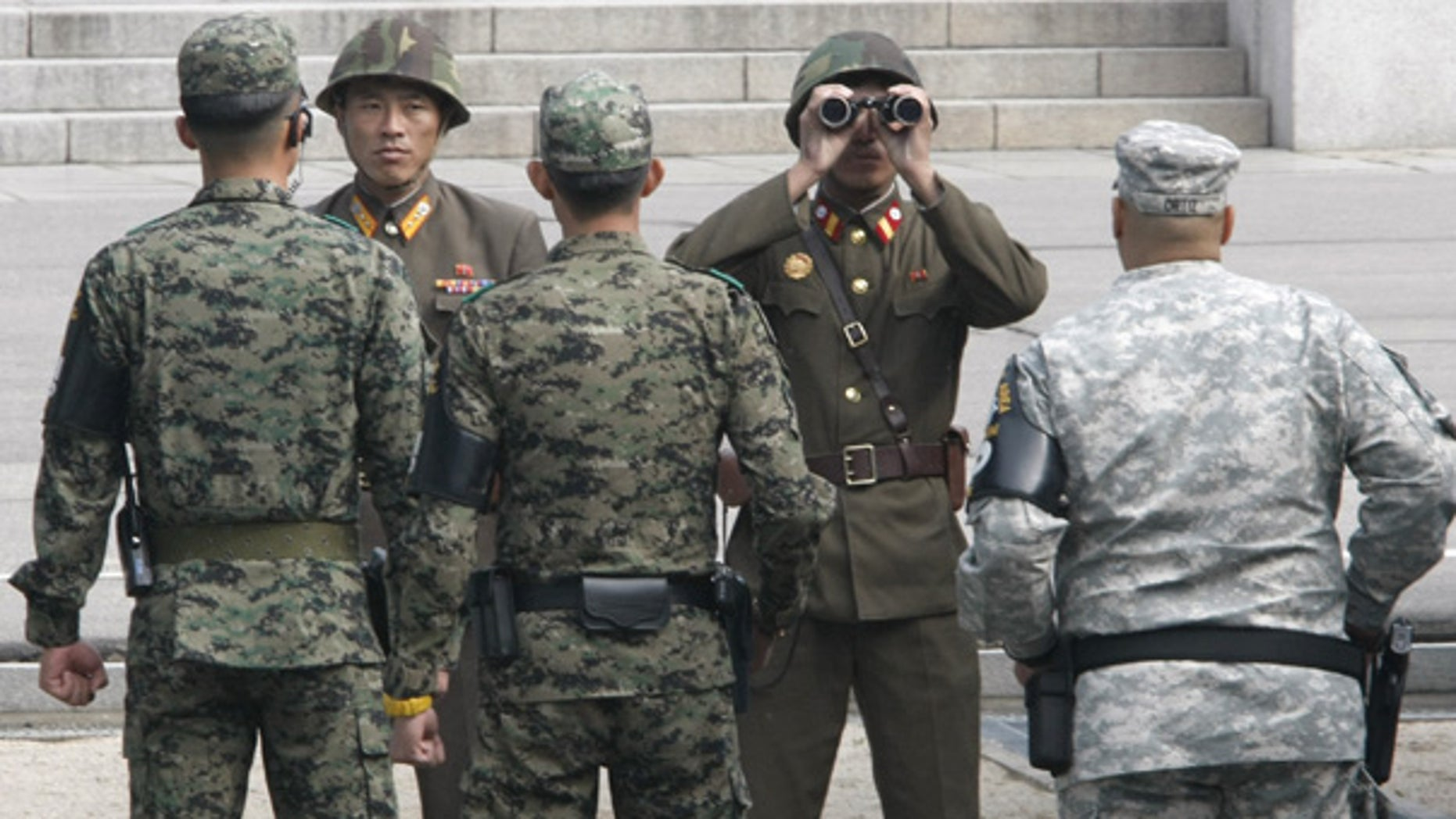 Oct. 20: North Korean soldiers look across the border as South Korean and U.S. Army soldiers stand guard.