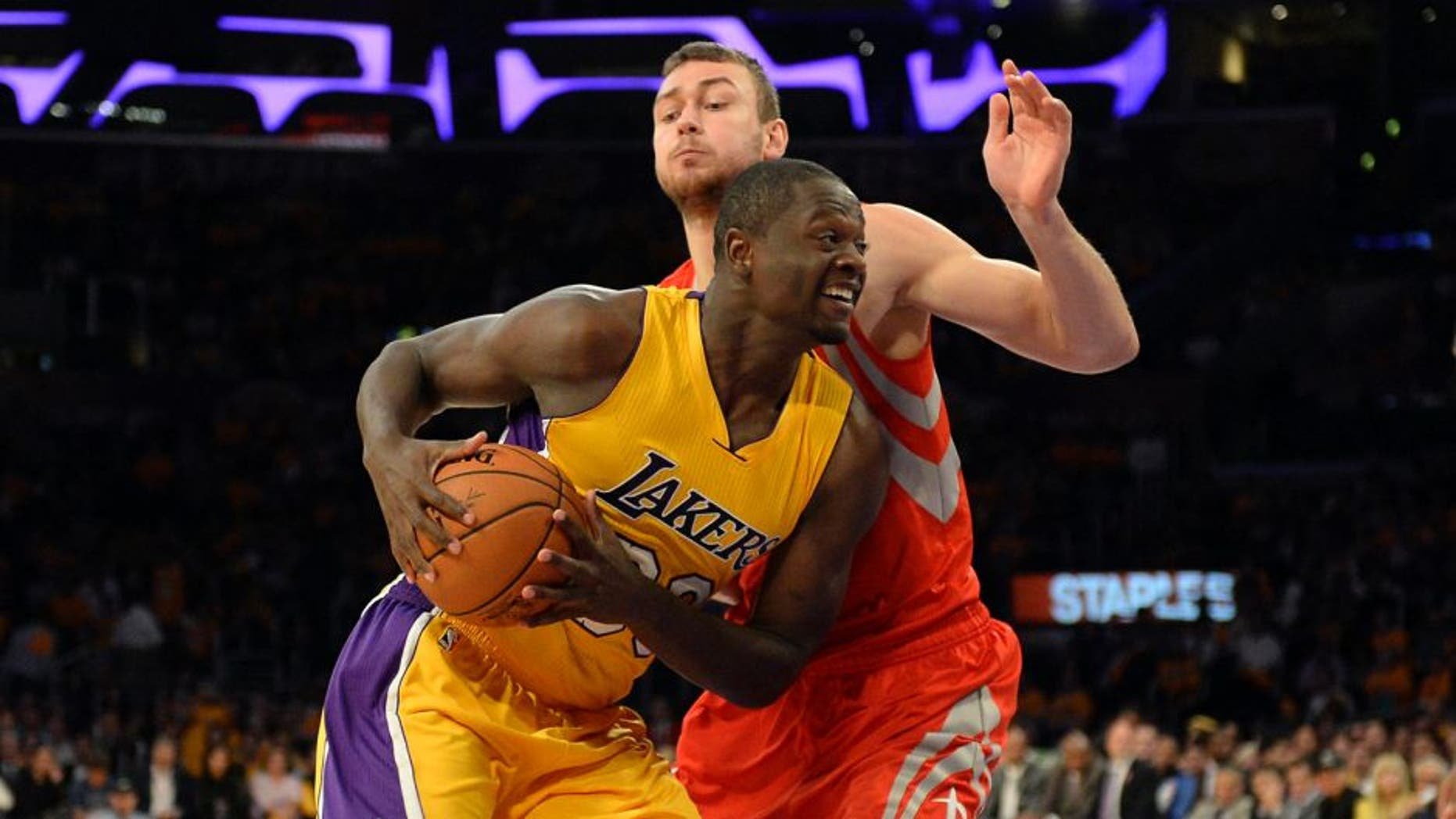 Oct 28, 2014; Los Angeles, CA, USA; Los Angeles Lakers forward Julius Randle (30) drives against Houston Rockets forward Donatas Motiejunas (20) during the second half at Staples Center. Mandatory Credit: Richard Mackson-USA TODAY Sports