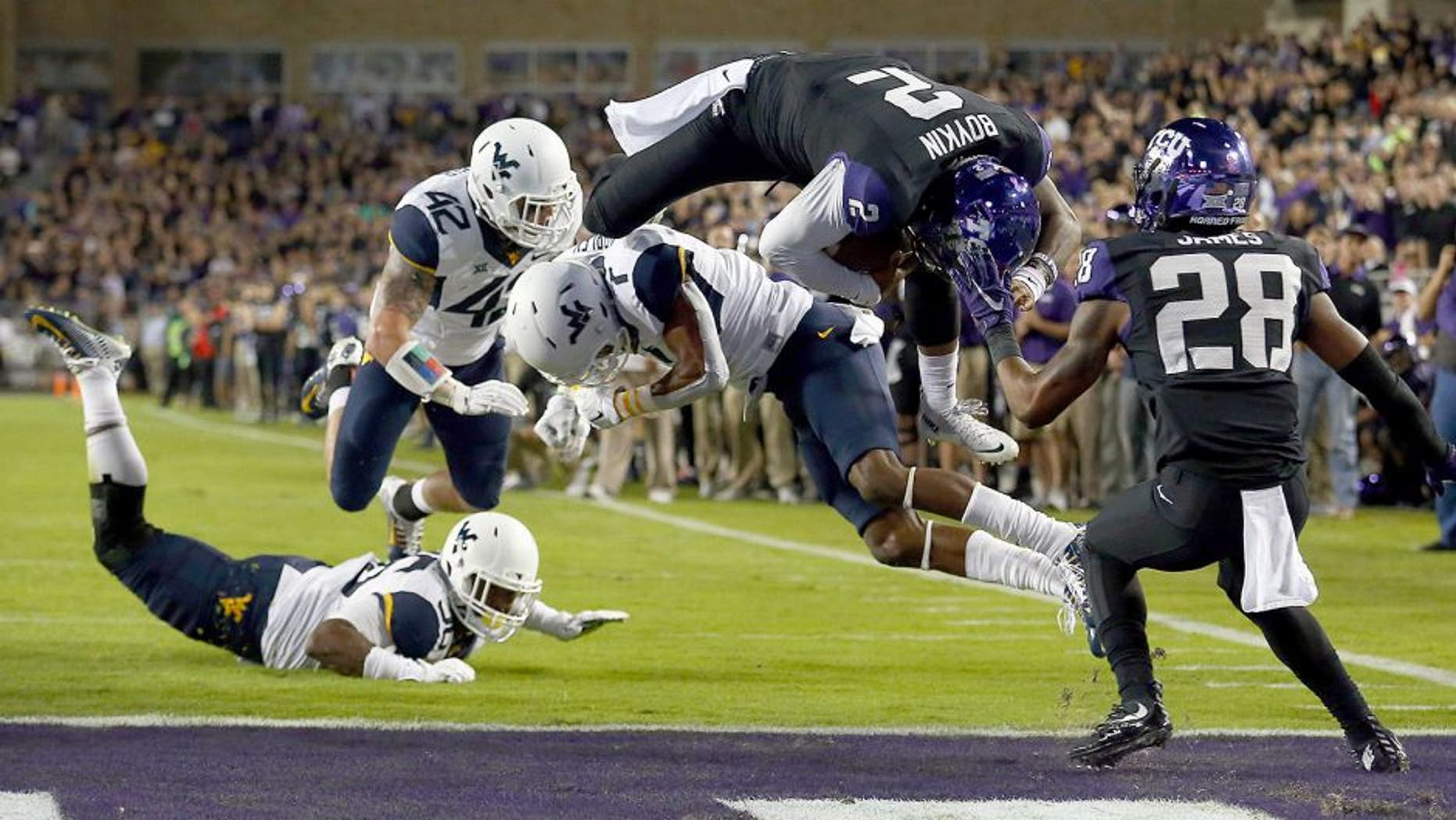 FORT WORTH, TX - OCTOBER 29: Trevone Boykin #2 of the TCU Horned Frogs scores a touchdown against Daryl Worley #7 of the West Virginia Mountaineers in the first quarter at Amon G. Carter Stadium on October 29, 2015 in Fort Worth, Texas. (Photo by Tom Pennington/Getty Images)