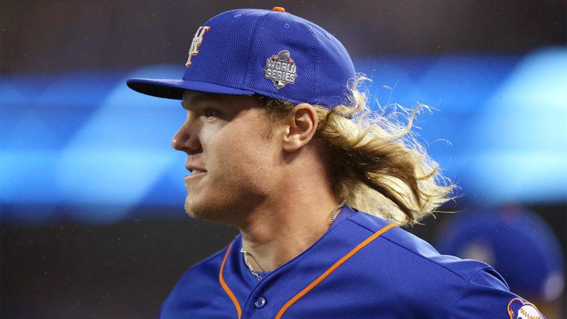 KANSAS CITY, MO - OCTOBER 27: Noah Syndergaard #34 of the New York Mets walks on the field during Game 1 of the 2015 World Series against the Kansas City Royals at Kauffman Stadium on Tuesday, October 27, 2015 in Kansas City, Missouri. (Photo by Brad Mangin/MLB Photos via Getty Images)
