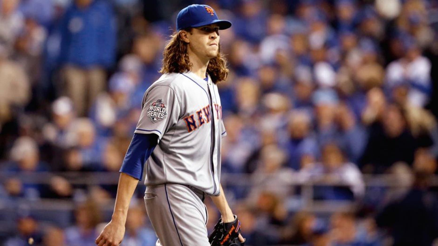 KANSAS CITY, MO - OCTOBER 28: Jacob deGrom #48 of the New York Mets reacts after retiring the side in the second inning against the Kansas City Royals in Game Two of the 2015 World Series at Kauffman Stadium on October 28, 2015 in Kansas City, Missouri. (Photo by Christian Petersen/Getty Images)