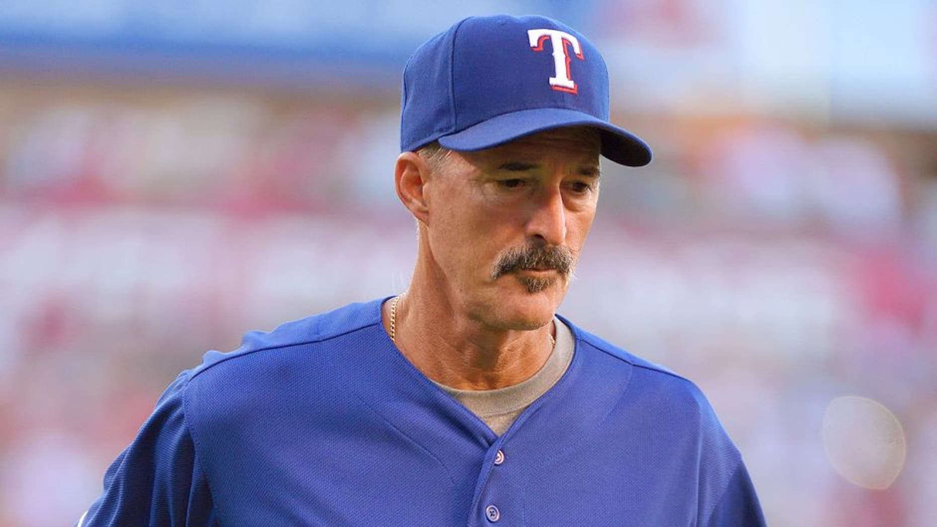 ANAHEIM, CA - JULY 25: Pitching coach Mike Maddux #31 of the Texas Rangers returns to the dugout after a visit to the mound during the second inning of the game against the Los Angeles Angels of Anaheim at Angel Stadium of Anaheim on July 25, 2015 in Anaheim, California. (Photo by Matt Brown/Angels Baseball LP/Getty Images)
