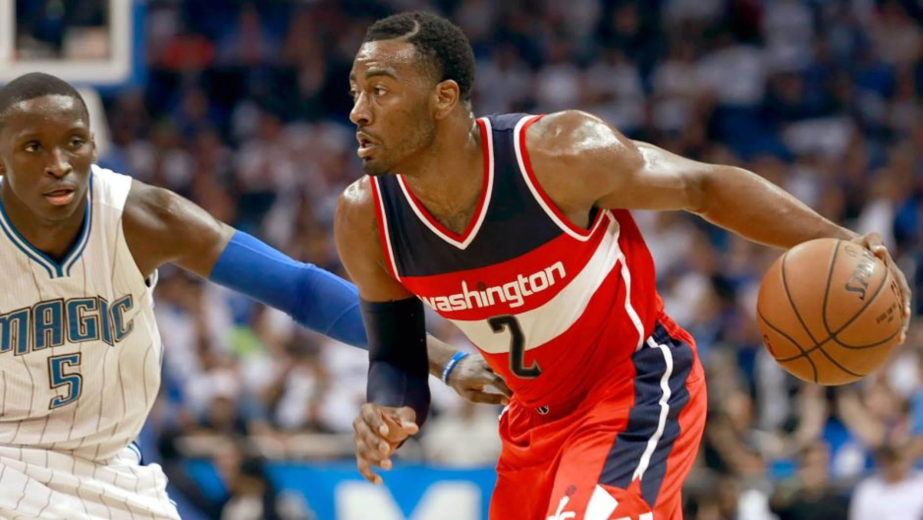 Oct 28, 2015; Orlando, FL, USA; Washington Wizards guard John Wall (2) drives to the basket as Orlando Magic guard Victor Oladipo (5) defends during the second quarter at Amway Center. Mandatory Credit: Kim Klement-USA TODAY Sports