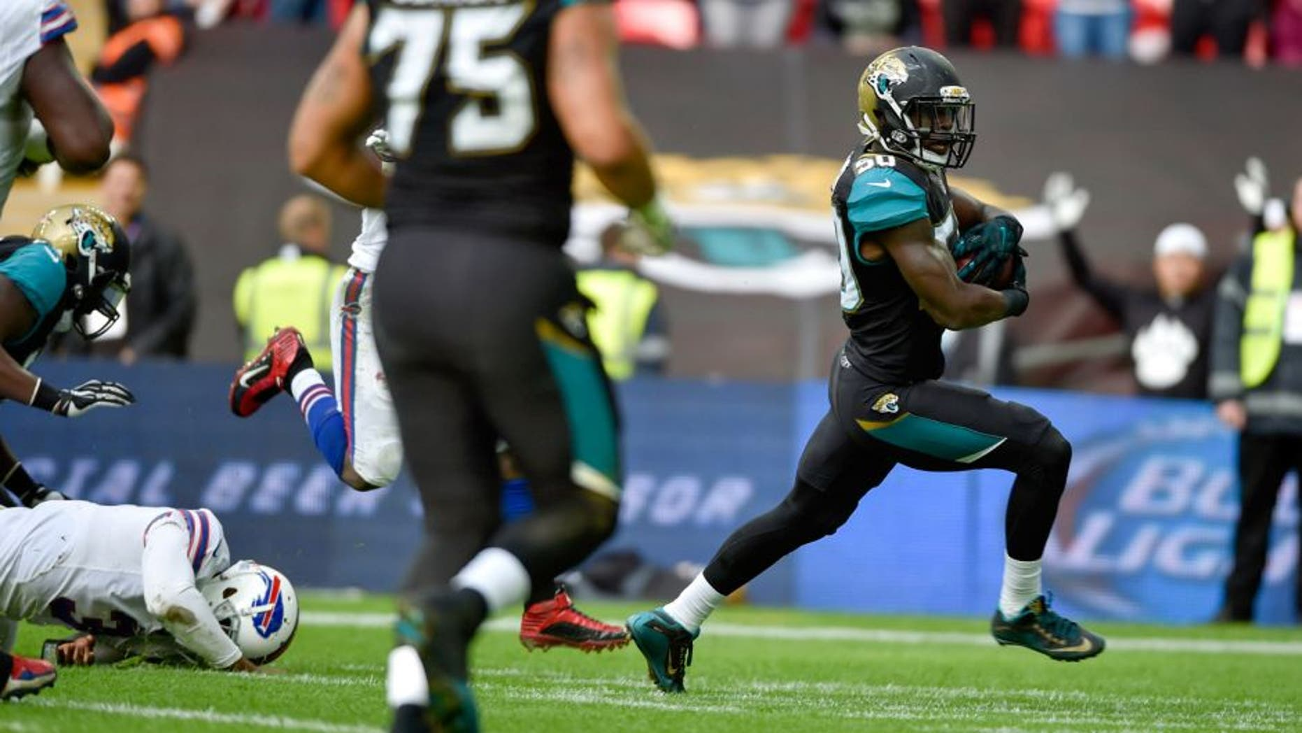 Oct 25, 2015; London, United Kingdom; Jacksonville Jaguars outside linebacker Telvin Smith (50) scores a touchdown during the first half of the game against the Buffalo Bills at Wembley Stadium. Mandatory Credit: Steve Flynn-USA TODAY Sports