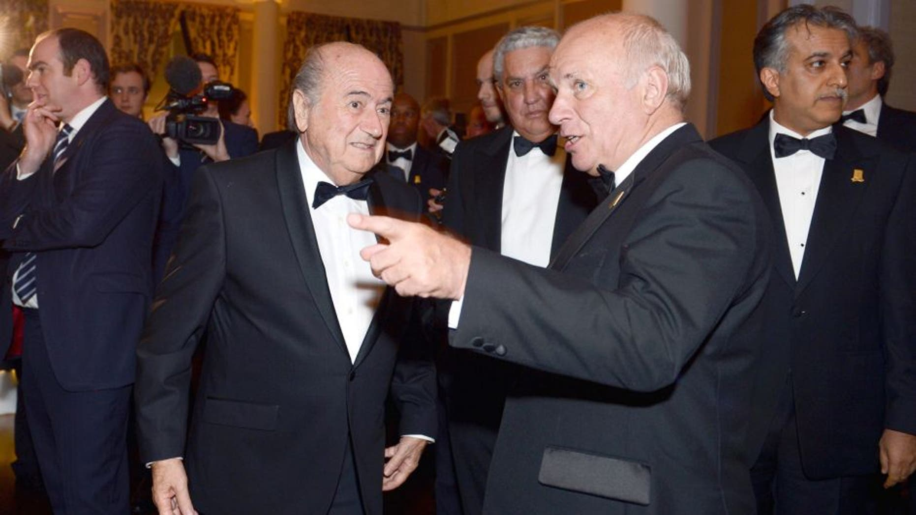 LONDON, ENGLAND - OCTOBER 26: Greg Dyke, FA Chairman talks to Joseph Blatter, FIFA President during the FA150 Gala Dinner commemorating the Football Association's 150th year at the Grand Connaught Rooms on October 26, 2013 in London, England. (Photo by Michael Regan/The FA via Getty Images)